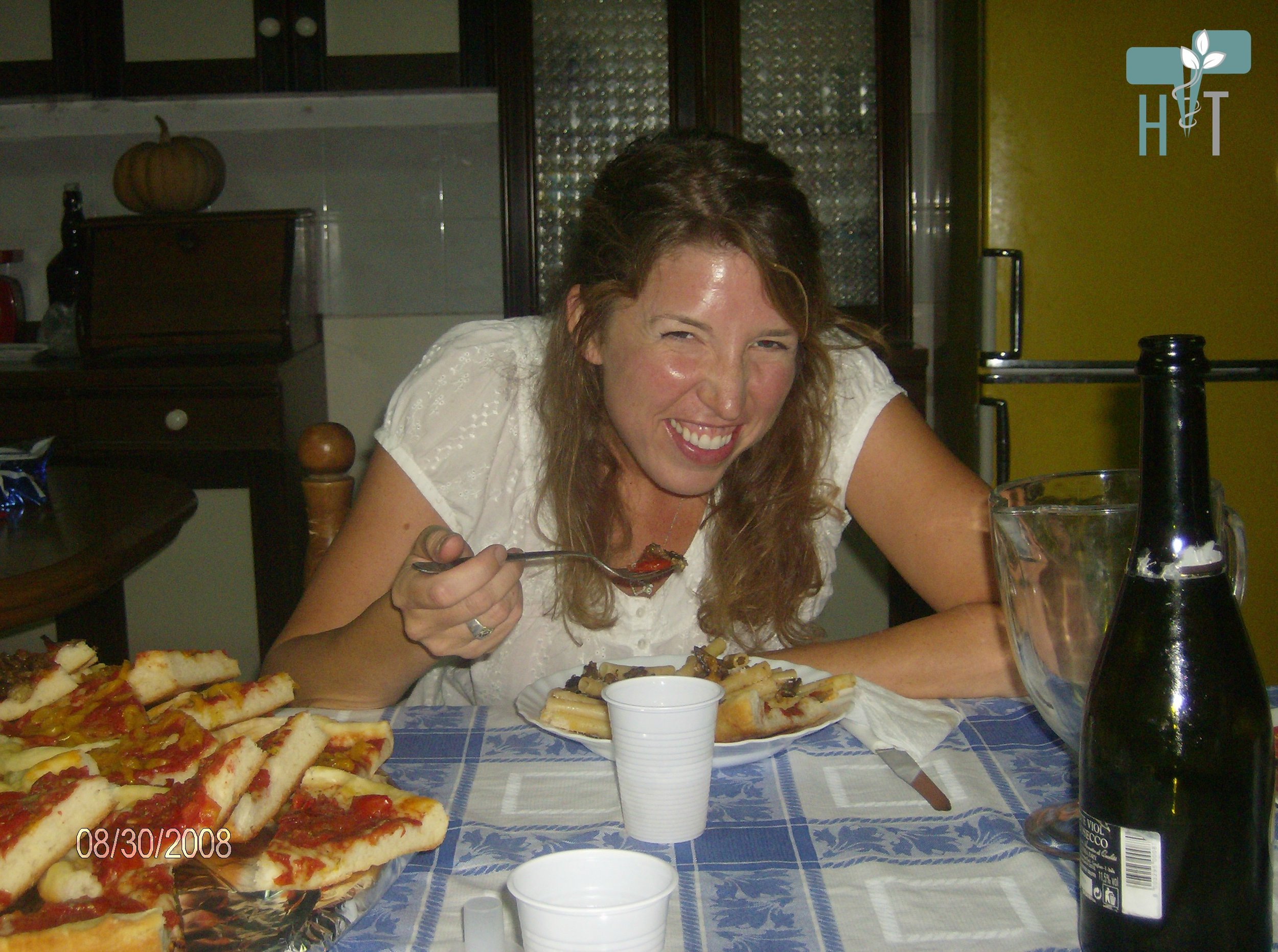 Me eating true Italian pizza and wine in my Italian landlord's kitchen.