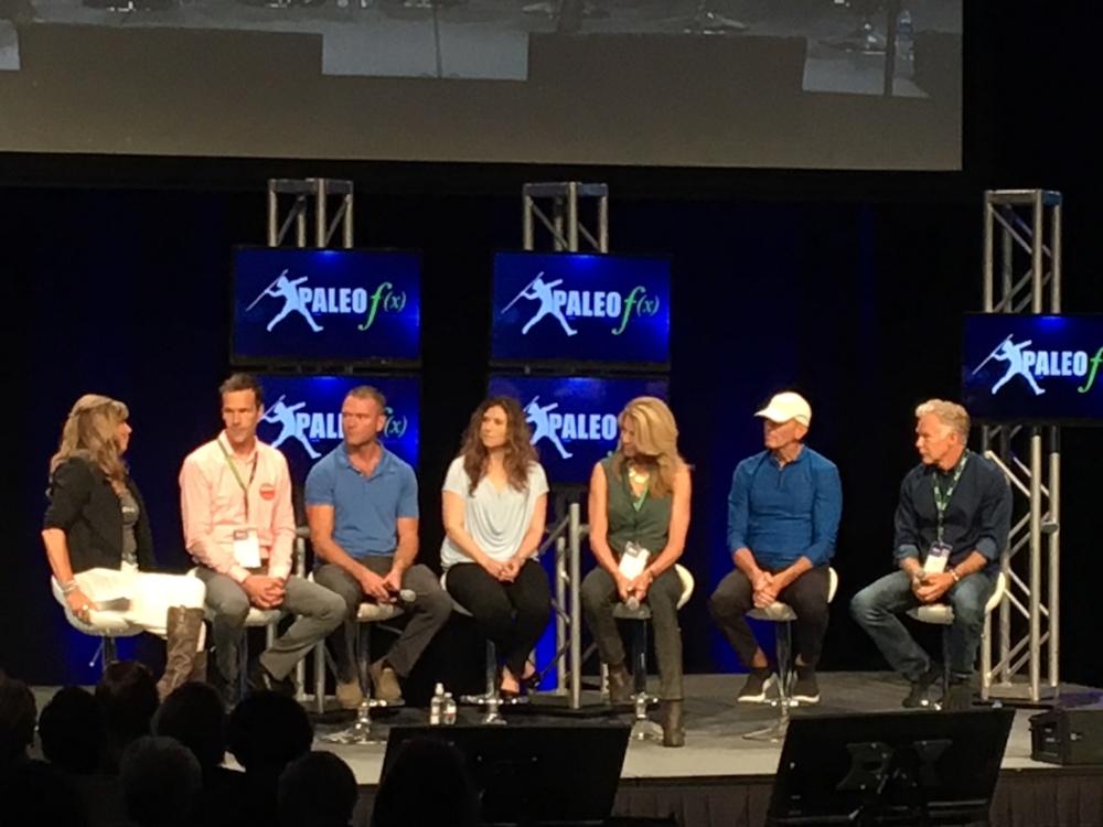 The Mastermind Panel at Paleo f(x) 2018,From left to right: Michelle Norris, Chris Kresser, Robb Wolf, Dr. Sarah Ballantyne, J.J. Virgin, Dr. Joe Mercola, & Mark Sisson