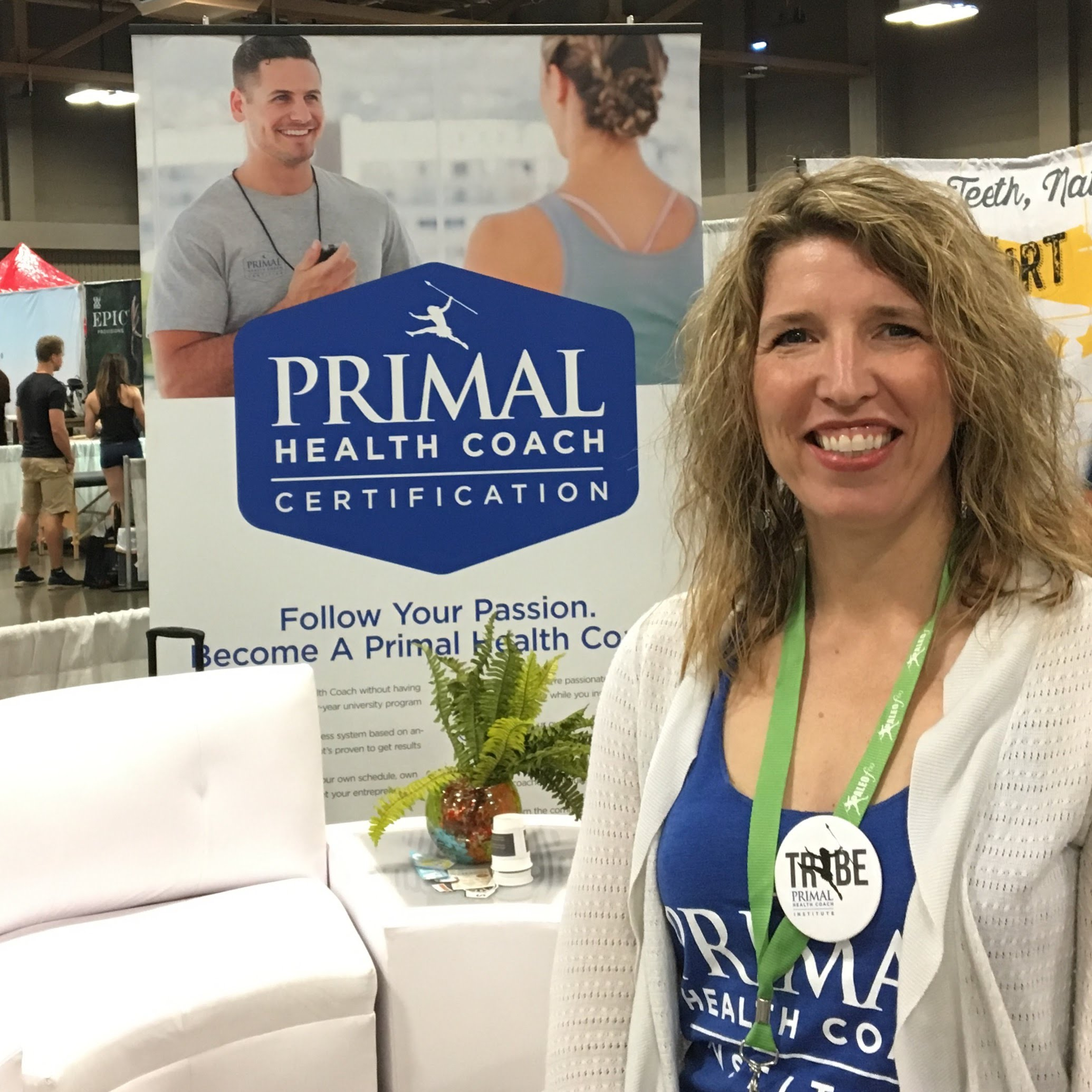 Pictured here at the Primal Health Coach Institute booth at the 2018 Paleo f(x) Conference in Austin, TX