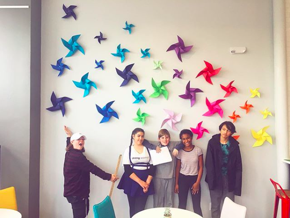 DMHS Students posing in front of the completeed feature wall!