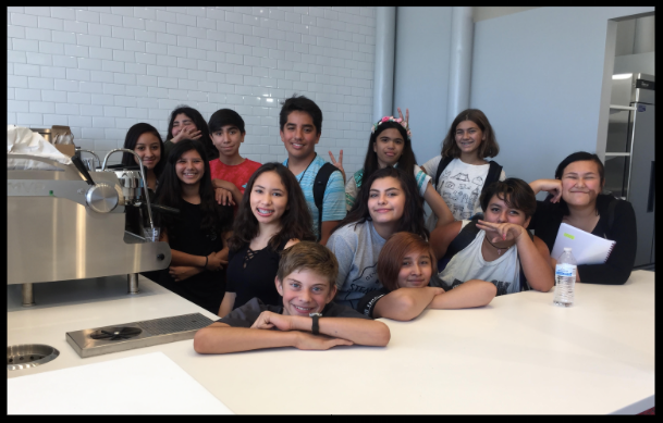 Students from DMHS visiting the Pinwheel Coffee construction site in August, 2017.