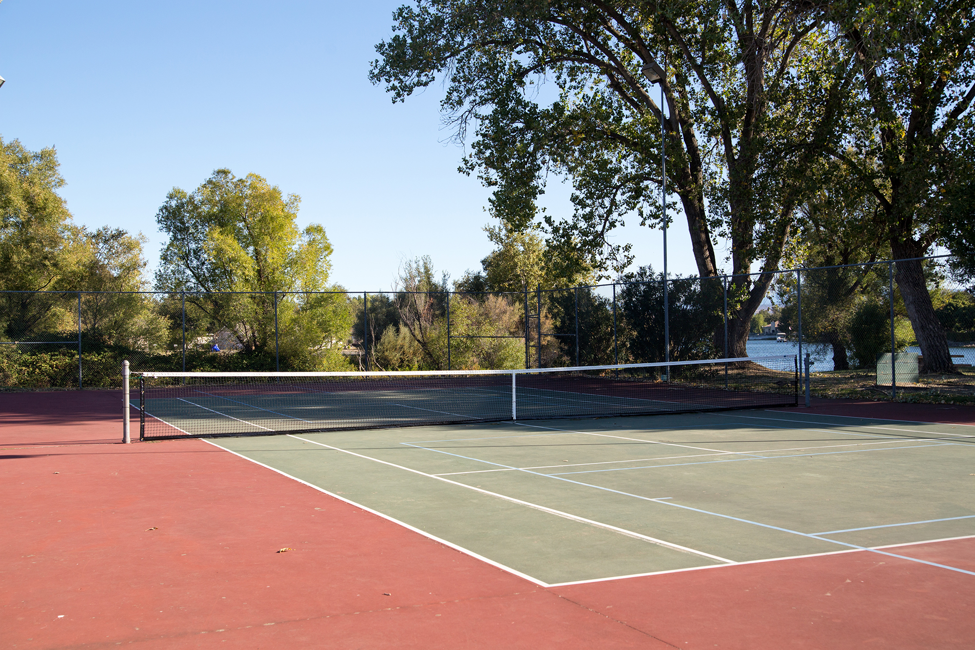 Tennis Court - The tennis courts, located near The Lake Club, are constantly maintained so that residents have an opportunity to participate in this ageless sport.  Lights on the courts allow residents to compete into the evening.