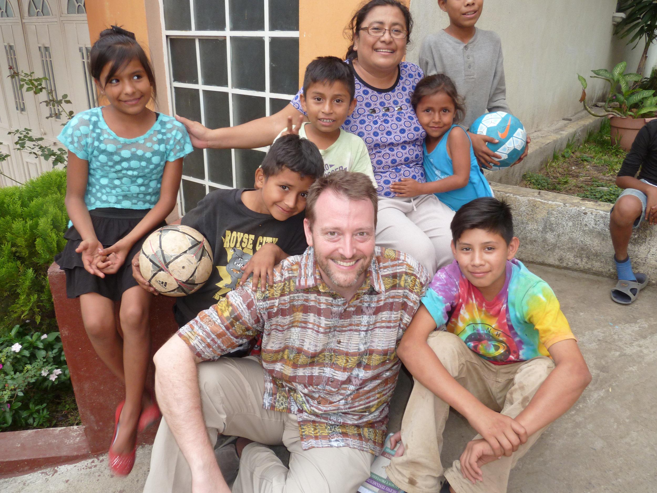 Pastor Chris Romig with children in Guatemala