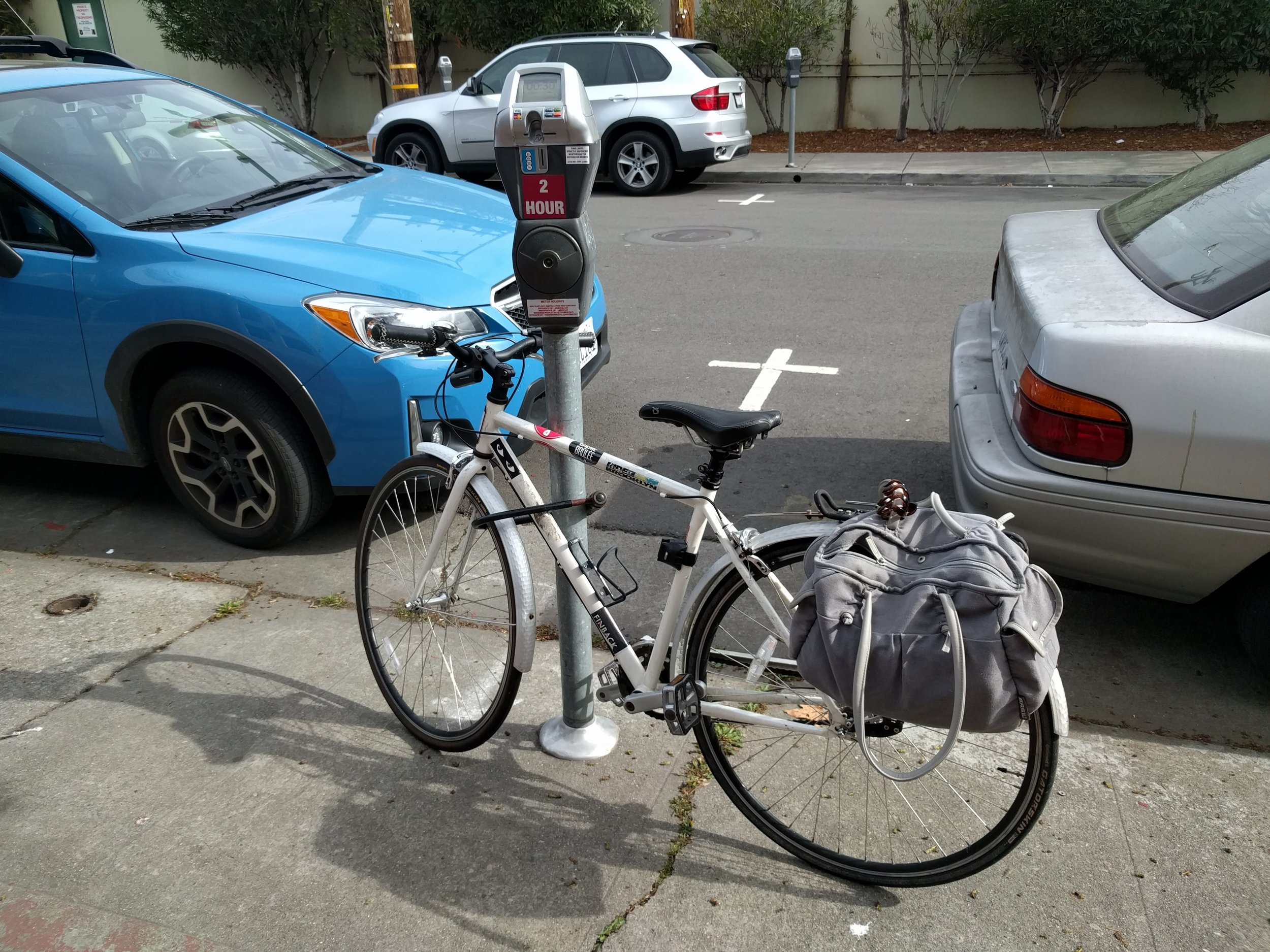 Yet another cool thing about biking: you can almost always get a free parking spot directly in front with no time limit ;).  Pictured here, my loyal 3-speed Swobo hybrid bike that I find ideal for urban riding.