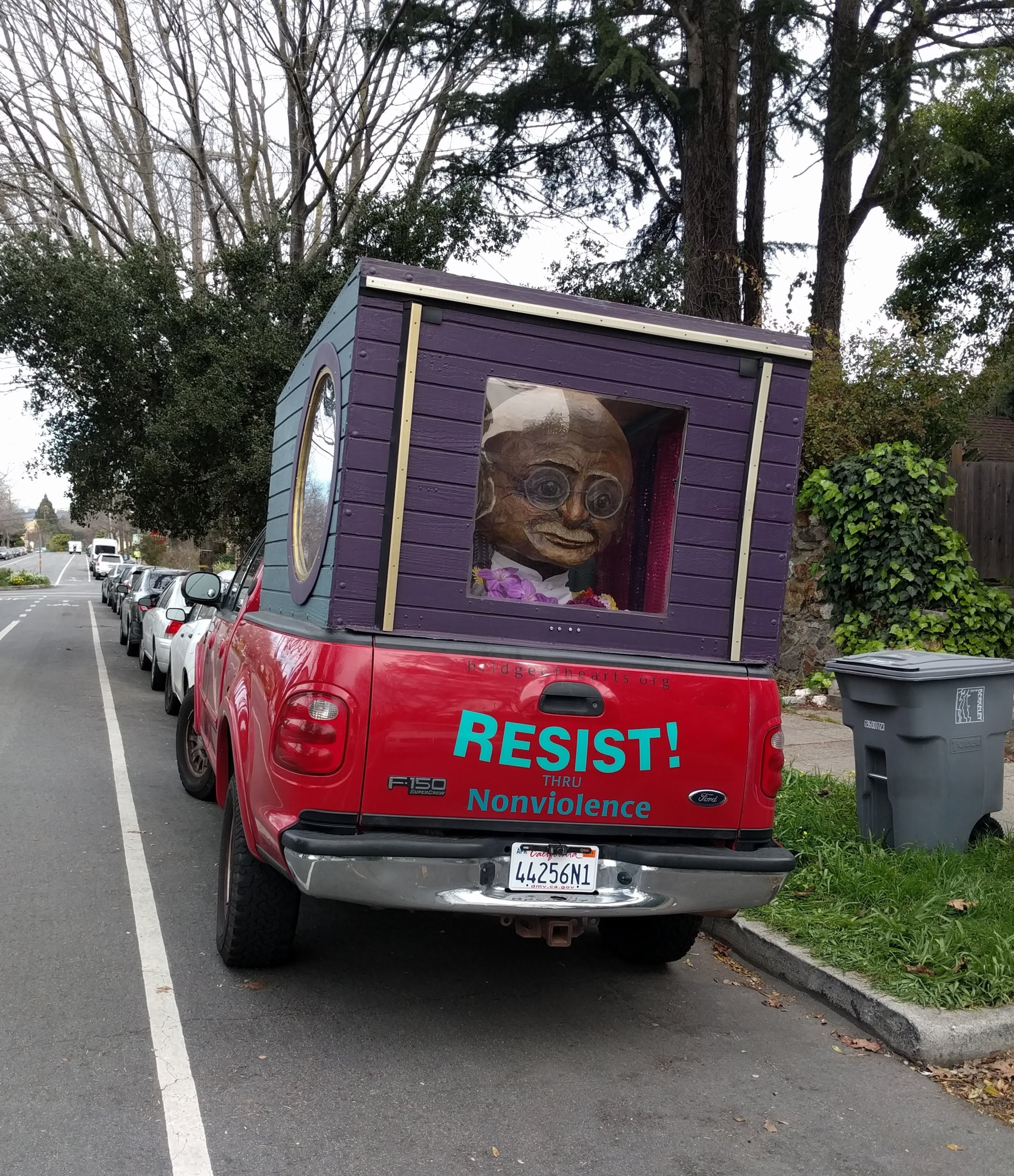 Thanks to my bike ride, I got to witness this anti-popemobile featuring Gandhi. Classic Berkeley.