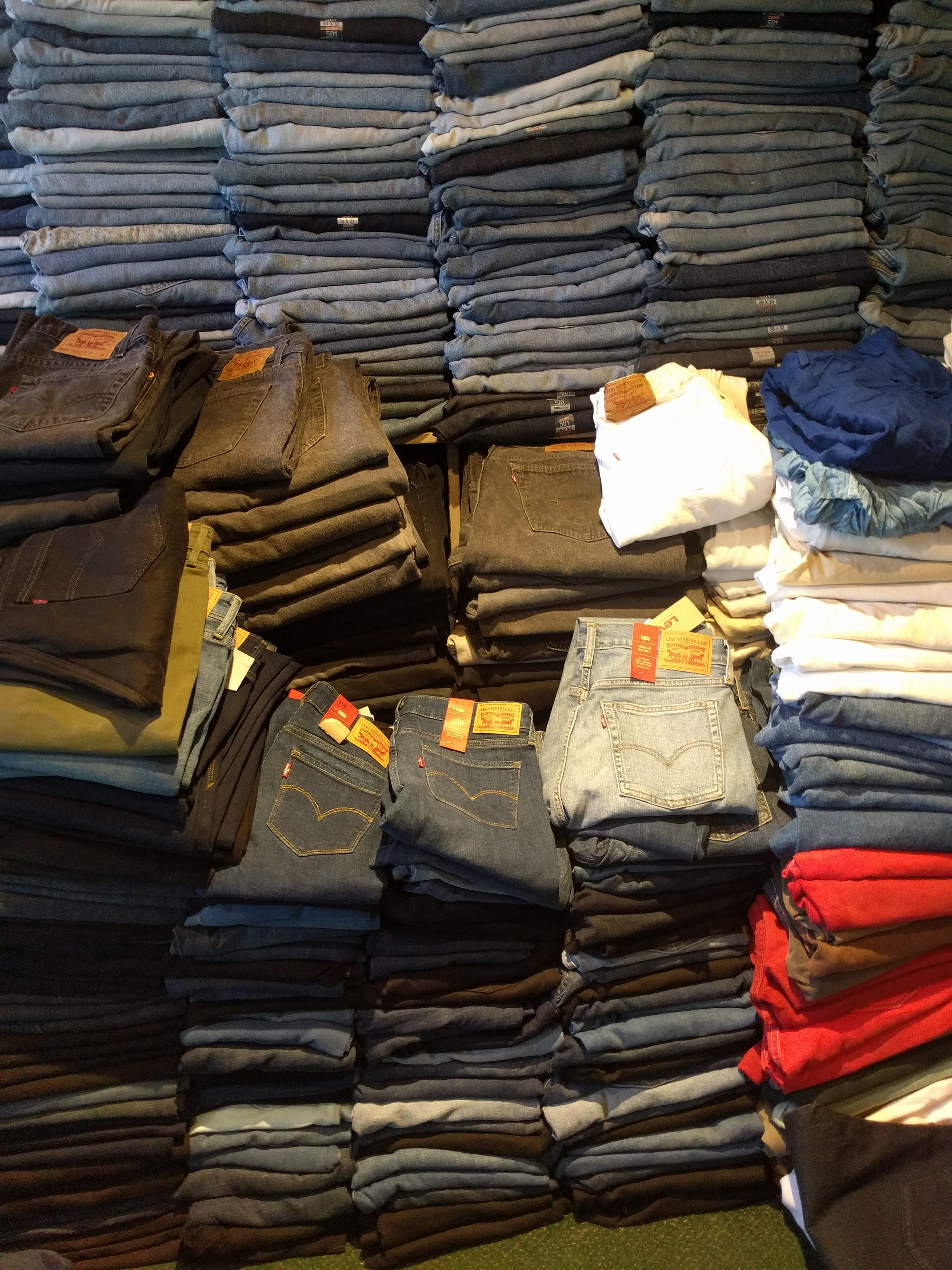 Stacks of jeans at  Slash Clothing , 2840 College Ave, conveniently located along the Russell Street Bicycle Boulevard!