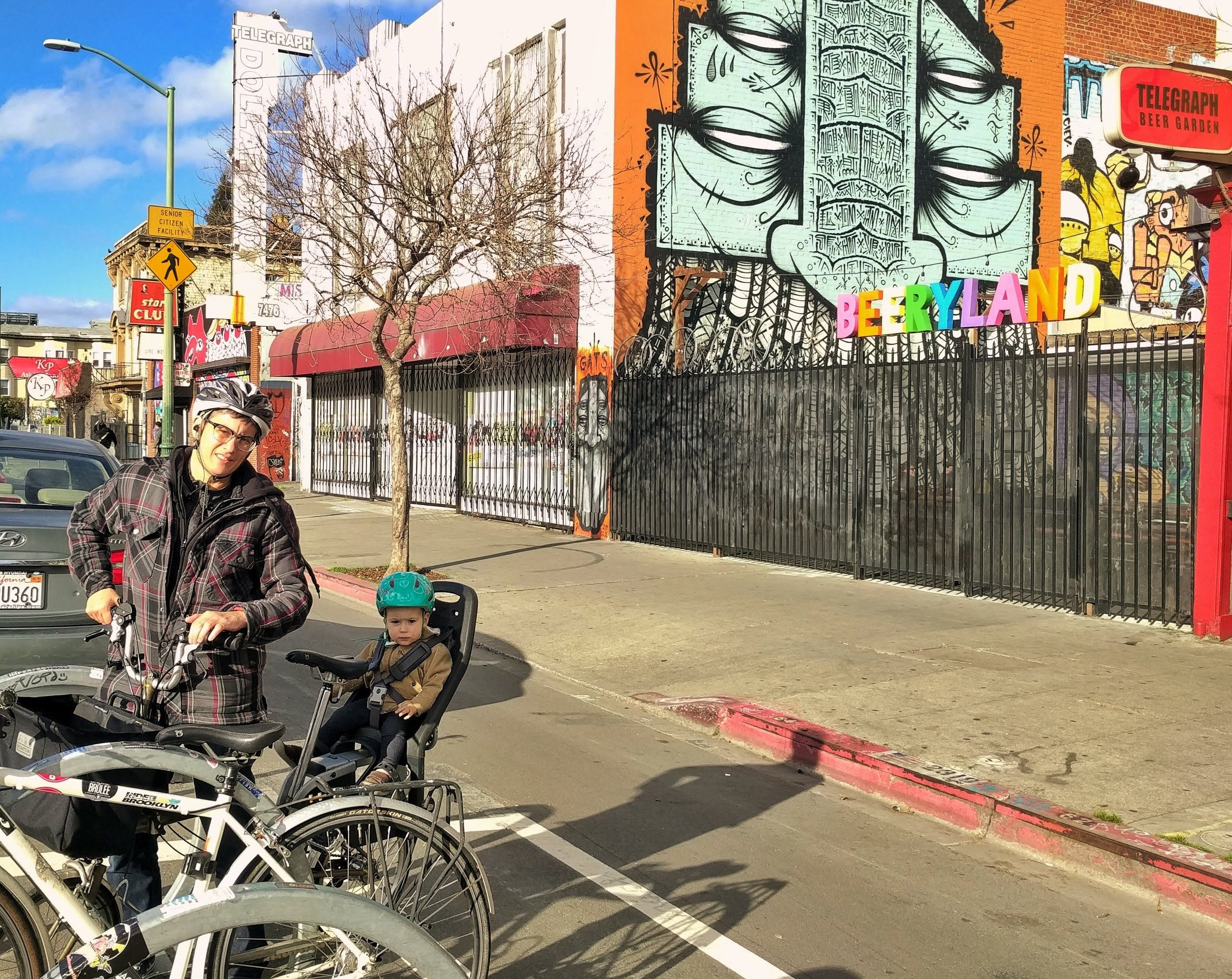"""'Beeryland,' AKA Telegraph Beer Garden  as seen from the convenient bicycle coral located out front, flanking Telegraph Avenuee's luxurious protected bike lane, which has achieved """"Stunning results""""  according to StreetsBlog ."""