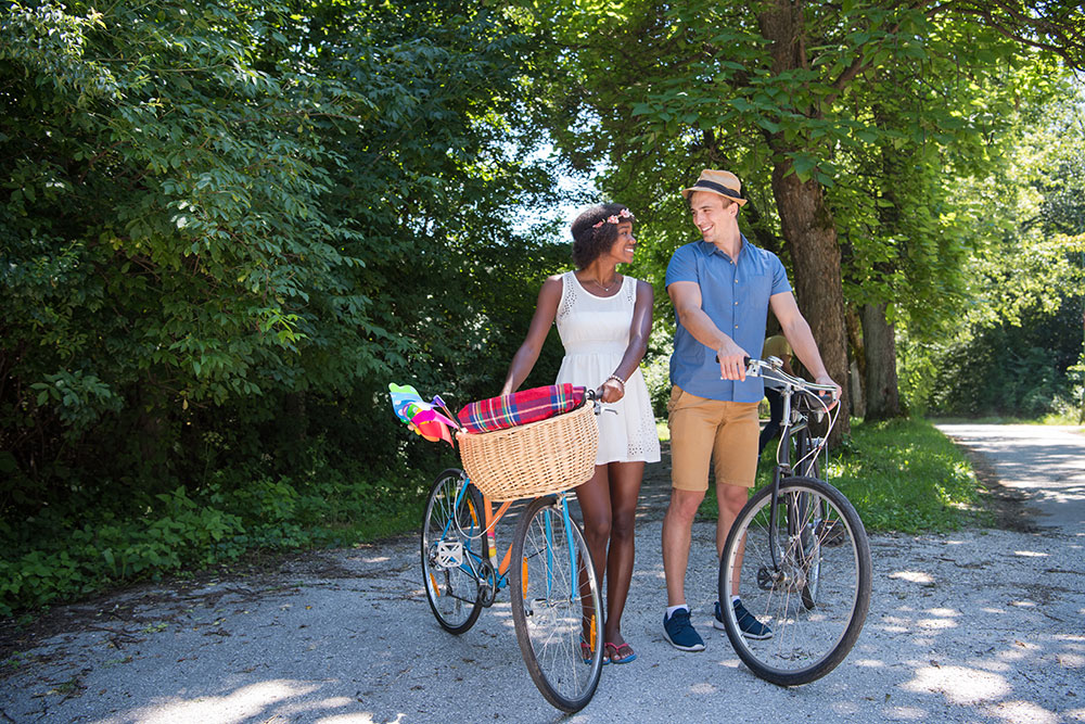 Smiling Couple Outside Riding Bicycles