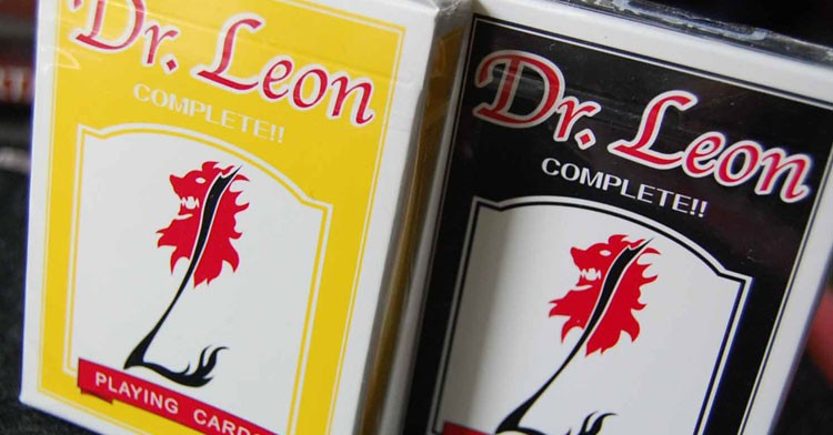 The Original Dr. Leon Playing Cards in both Black and Yellow.