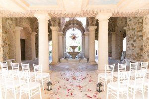 Fall ceremony decor with maple leaves and seeded eucalyptus