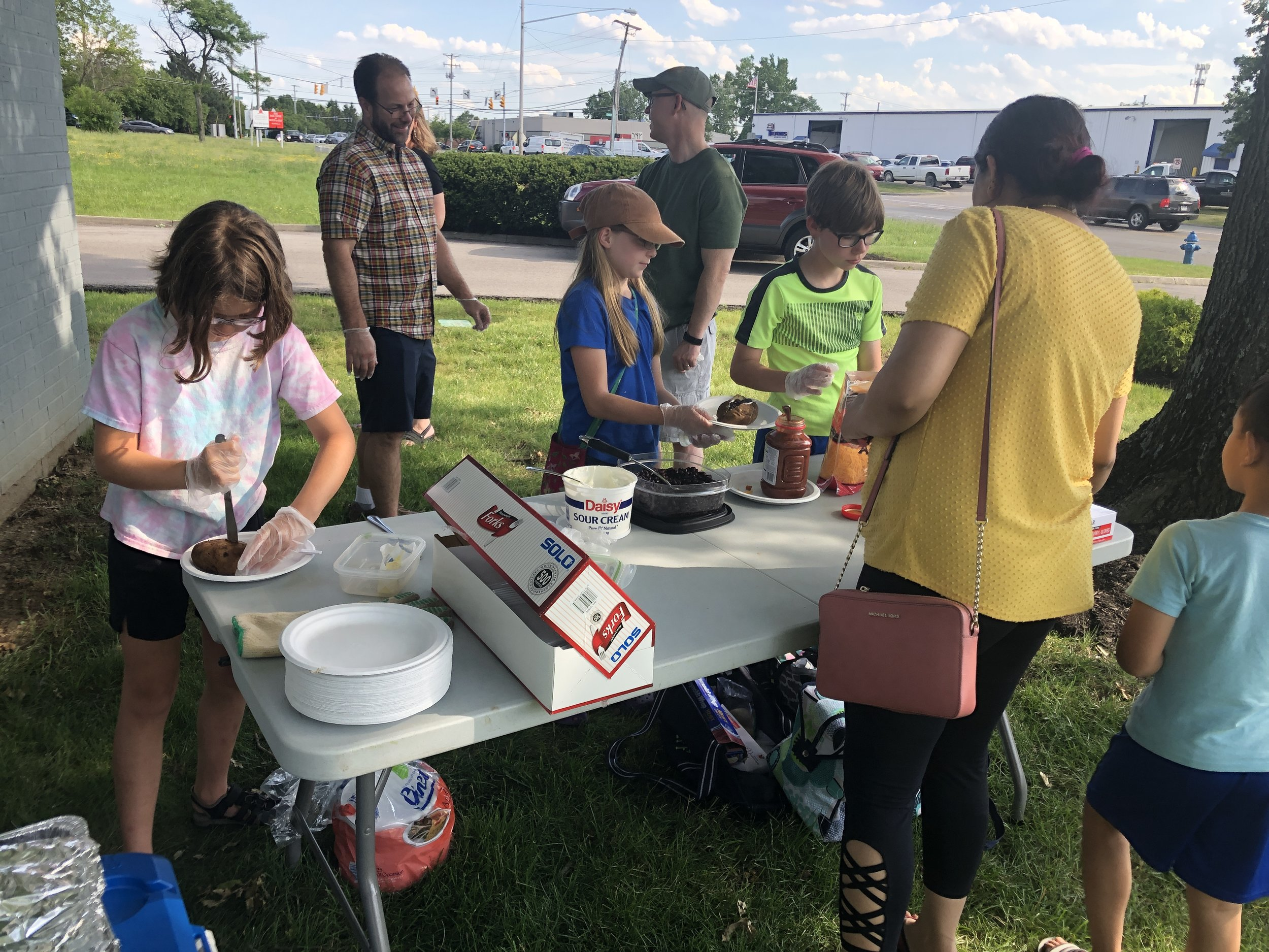 We are enjoying community meals this summer! -