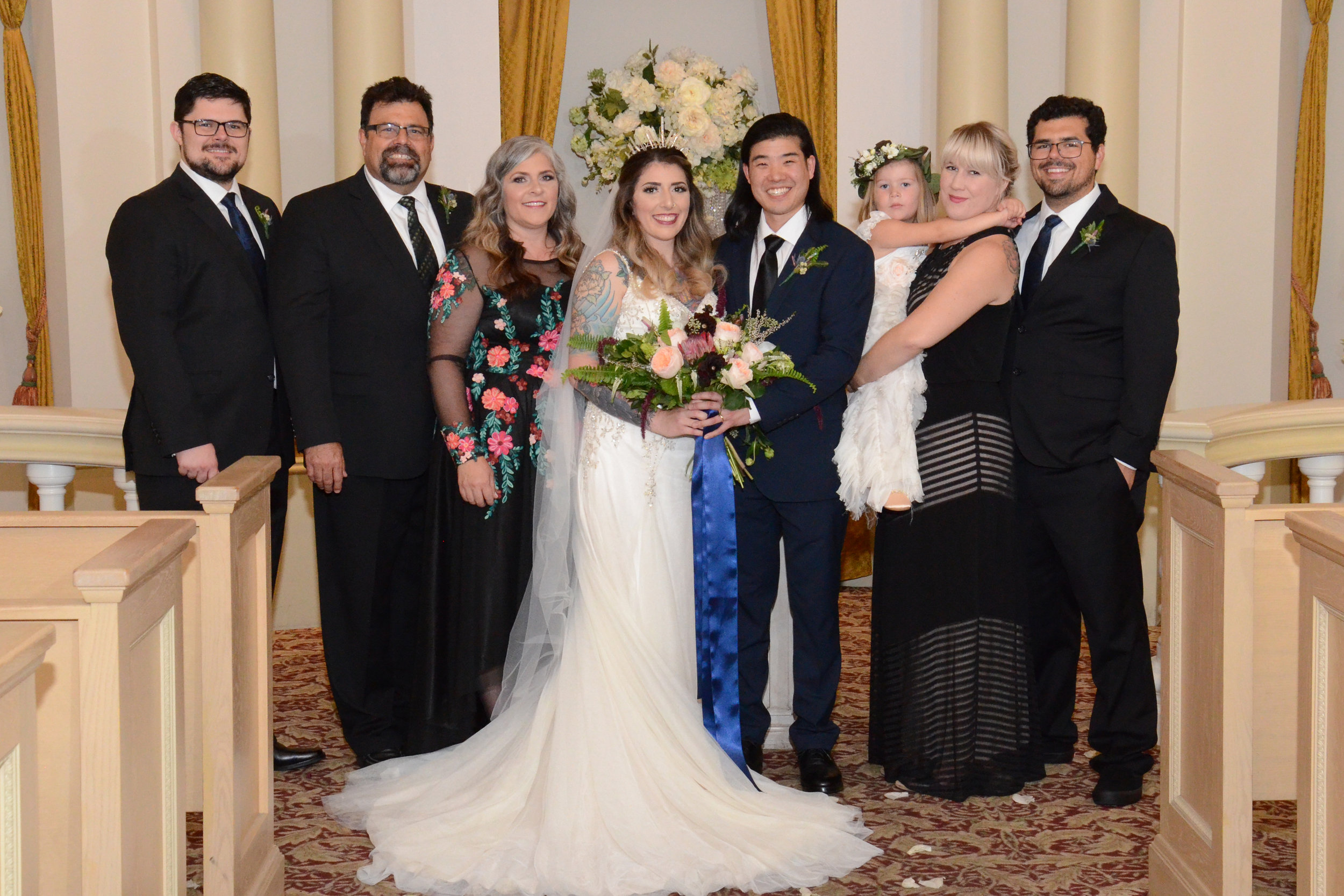 This is our whole crew from left to right is Patrick, Jeff, Michelle, Ashley, Scott, Layla, Lauren, and Gary. Ashley is wearing Andrea by Maggie Sottero for her wedding.