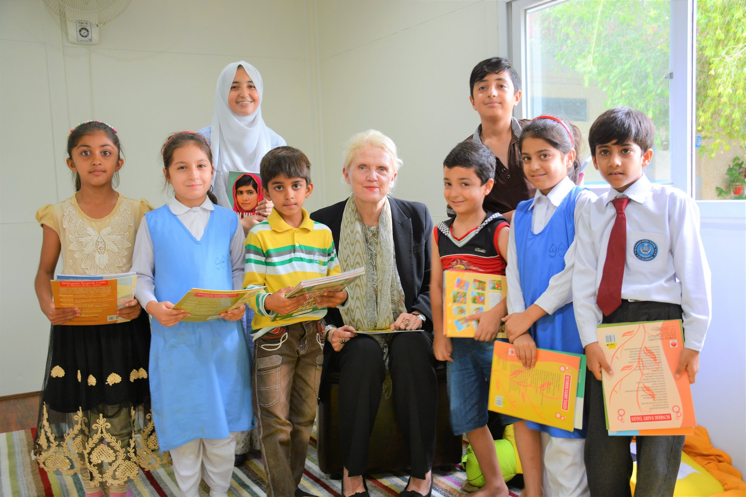 DFID Pakistan Deputy Head Judith Herbertson reading out to children on 31 July 2017, during the inauguration of a library that IMC Worldwide and UKAid donated to a primary school in Islamabad. Credit: Syed Abdullah Hameed/Humqadam.