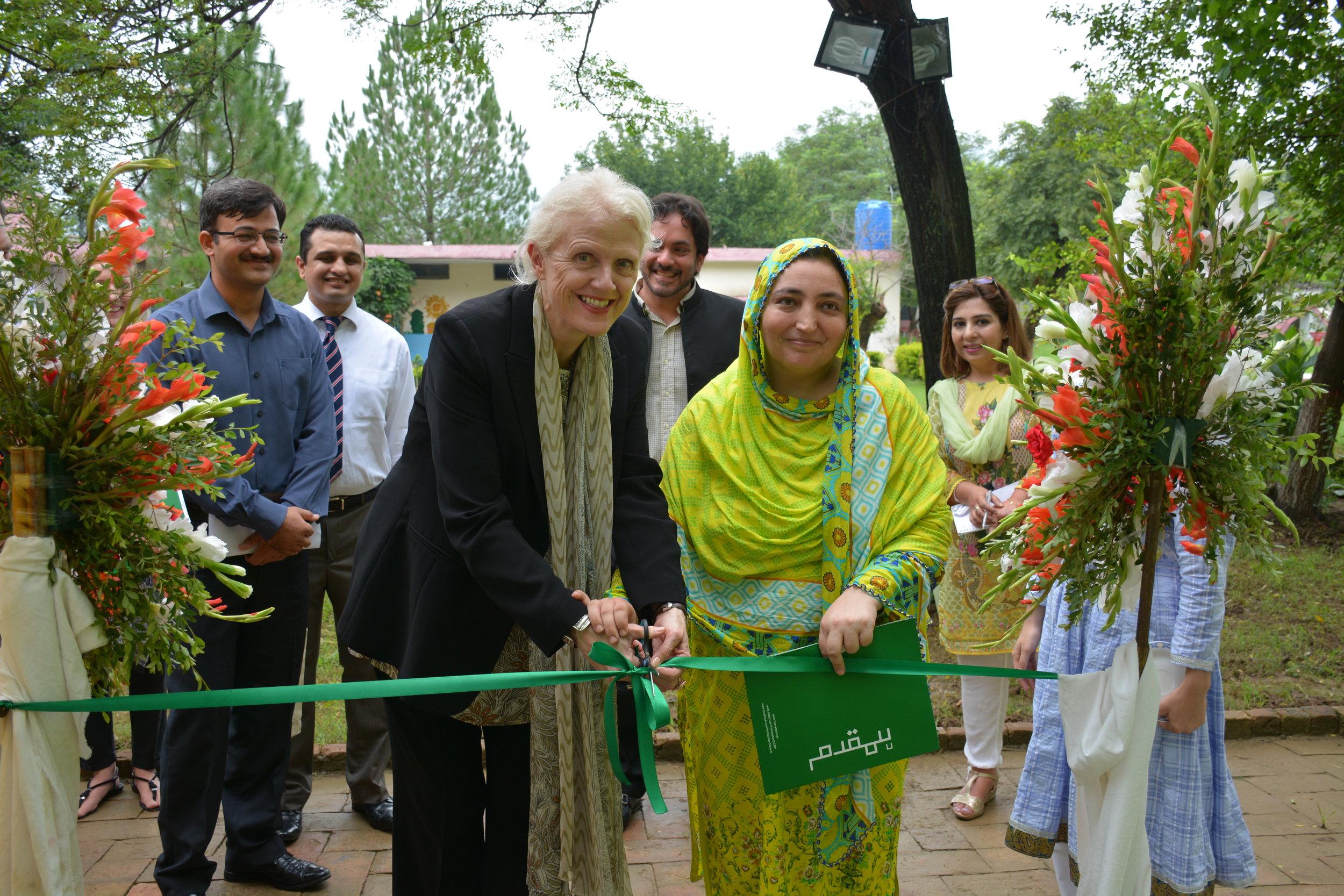 Pakistan Deputy Head Judith Herbertson and school's principal Sajida Bibi cut the ribbon at the library inauguration ceremony in Islamabad on 31 July 2017. Credit: Syed Abdullah Hameed/Humqadam.