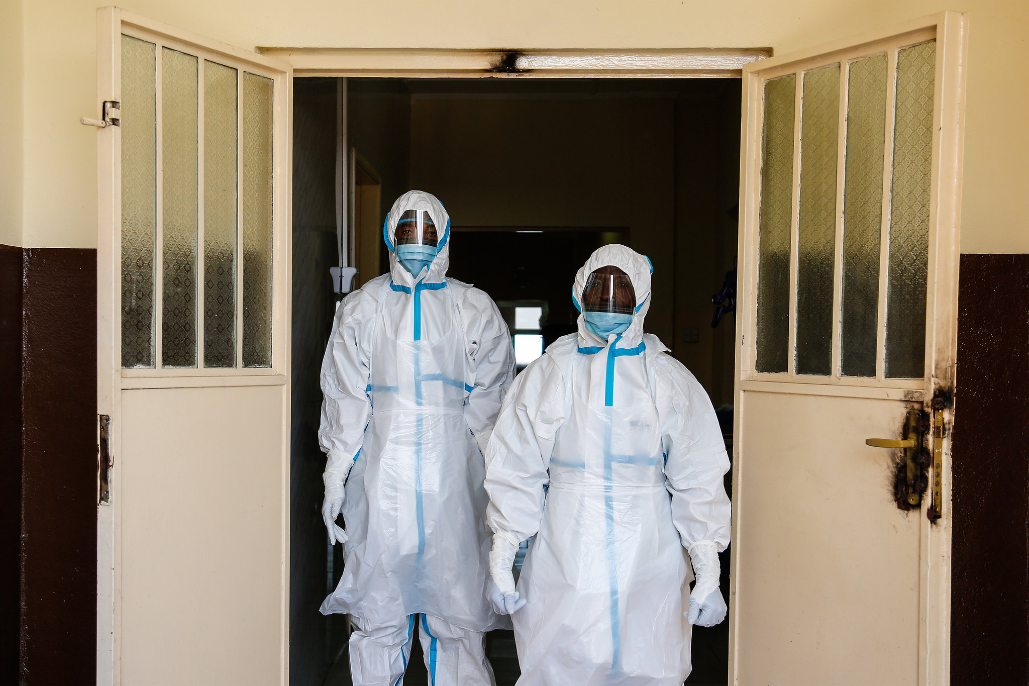 Front-line medics in full safety gear during the 2017 Ebola outbreak in Sierra Leone. Source:      DFID Flickr     .