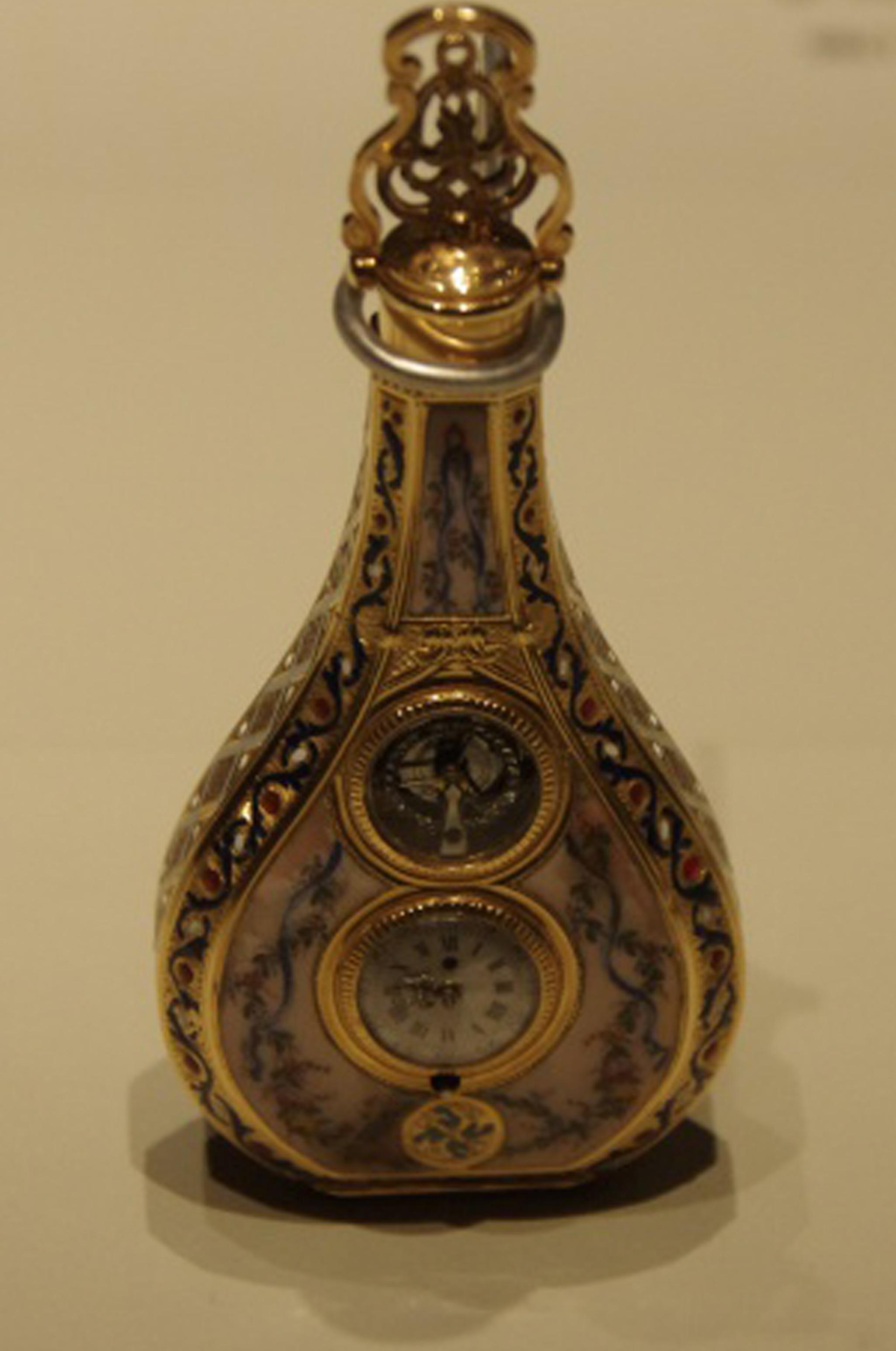 montre en forme de flacon avec carillon