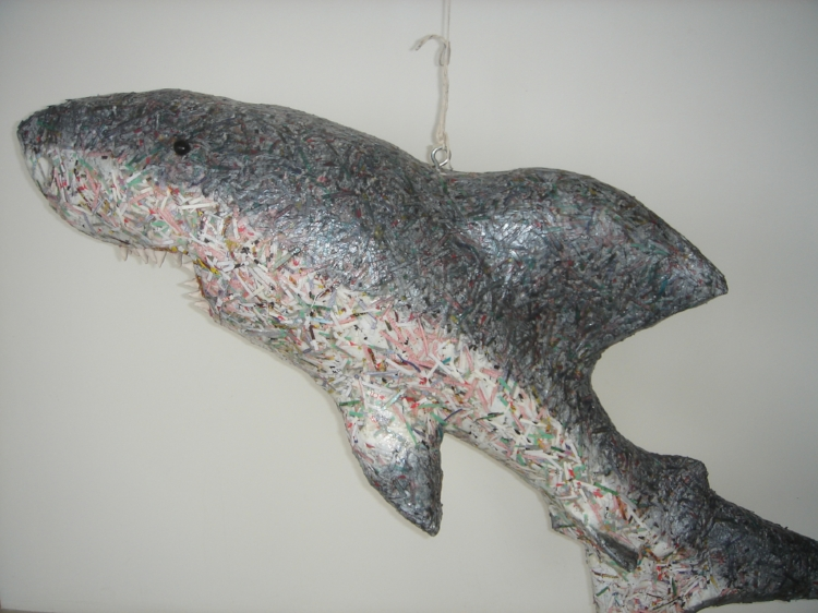 Card Shark sculpture by Amy LaBossiere. ©2007 all rights reserved. A 5-ft. shark covered in shredded playing cards with obsidian stone eyes and hand-sculpted clay teeth. Sold at auction to benefit an arts organization in New Haven, CT