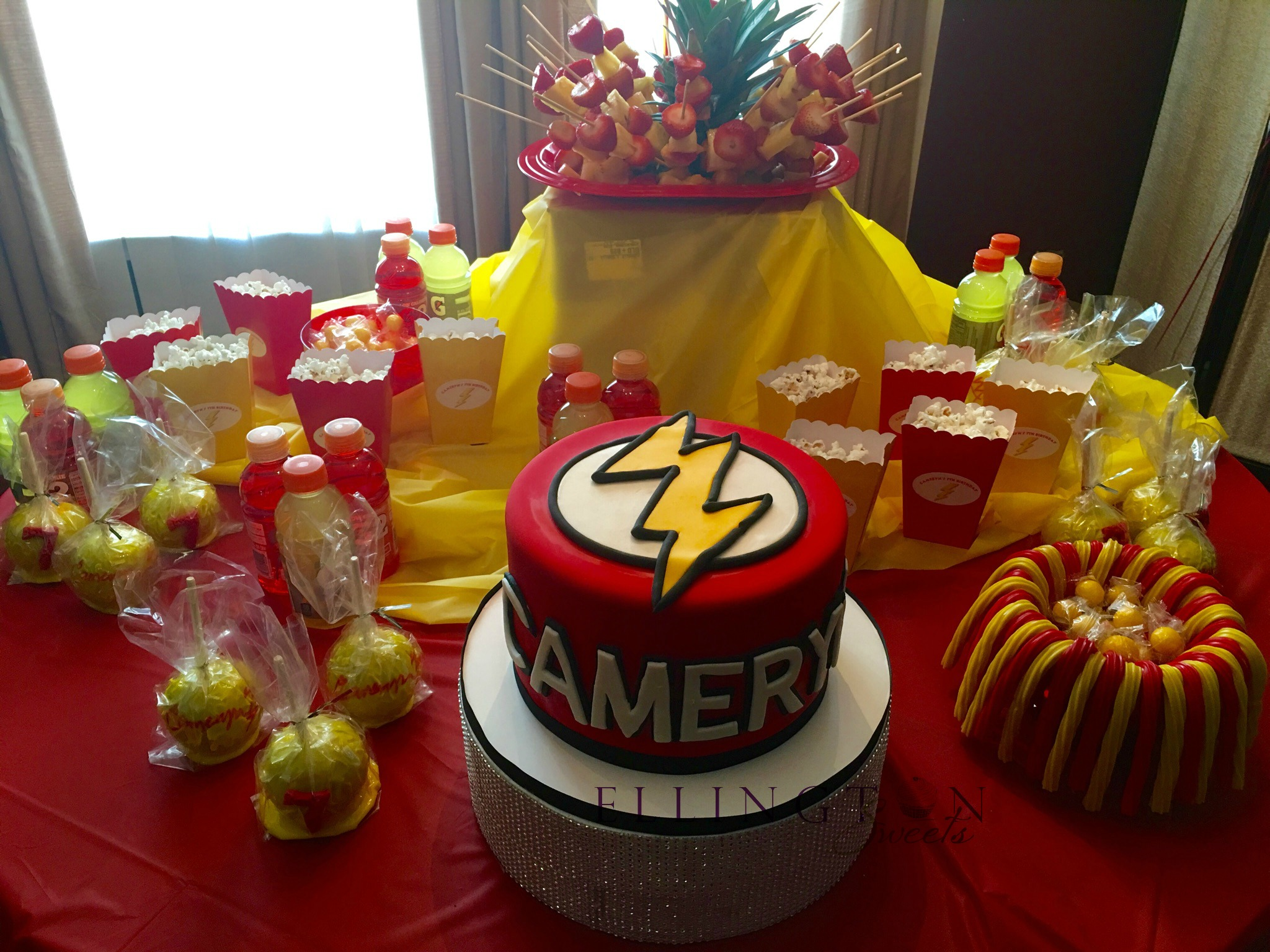 Cameryn_s Flash themed birthday cake set up.jpg
