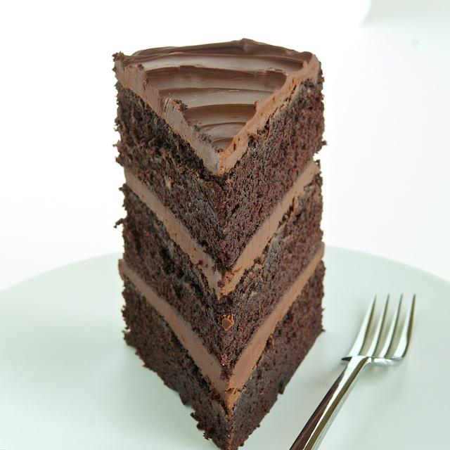 Chocolate Cake  Homemade chocolate cake infused with coffee and filed with milk chocolate frosting. Our chocolate frosting pairs perfectly with our wedding vanilla cake.