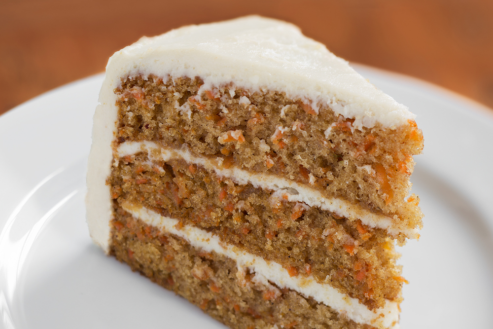 Carrot Cake  Sweet, moist, spice cake filled with carrots, toasted nuts and filled with cream cheese frosting. (nuts available upon request)