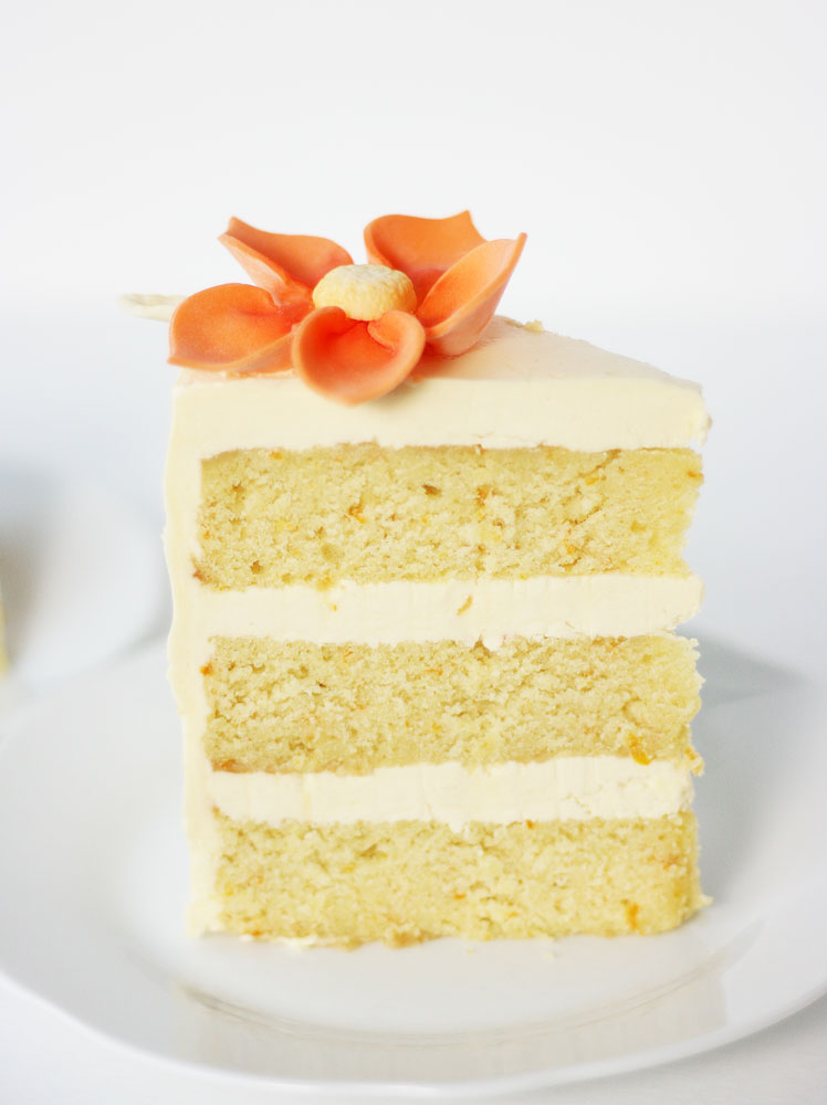 Orange Cream Cake  Our version of the orangesicle. Orange cake infused with orange flavor and orange juice and filled with orange cream cheese frosting.