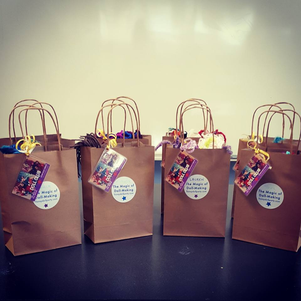 The doll is the loot!  Dollies go home in a recycled paper gift bag along with a personalized DOLL CLUB membership card