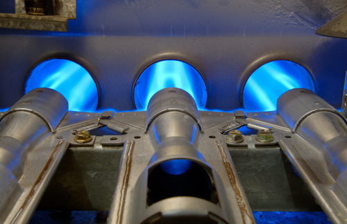 Inside-a-home-natural-gas-furnace-showing-blue-jets-of-fossil-fuel-burning..jpg