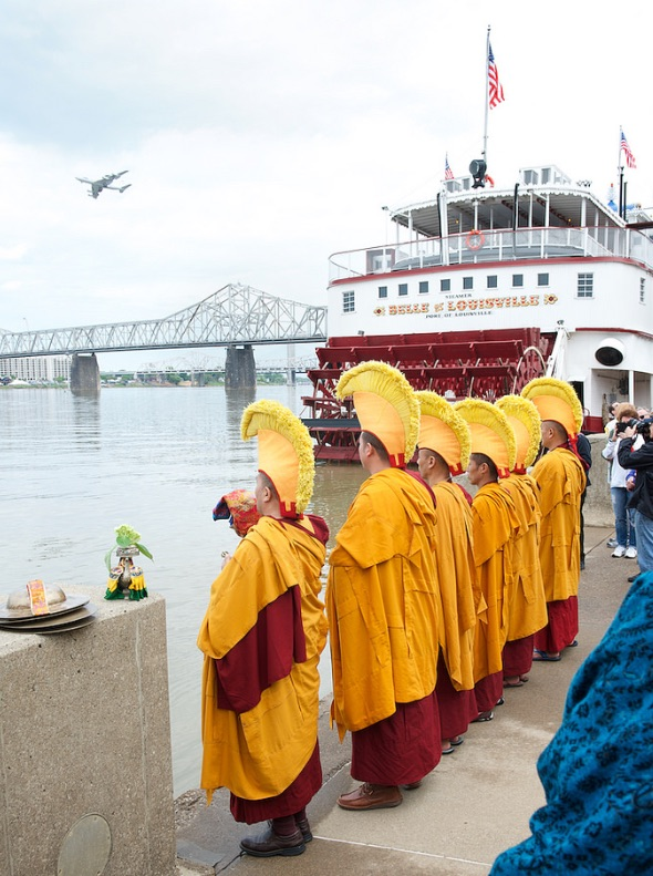 Monks dissolving the sand mandala into the Ohio River, part of the Festival of Faiths practices