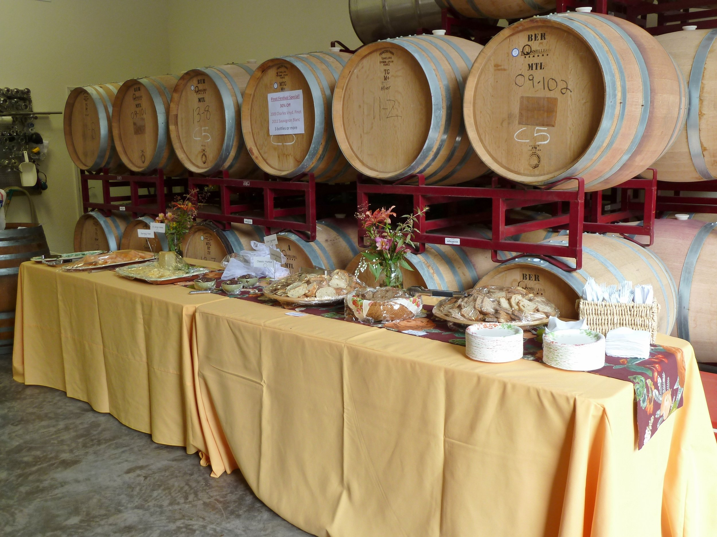 Food in front of barrels.JPG