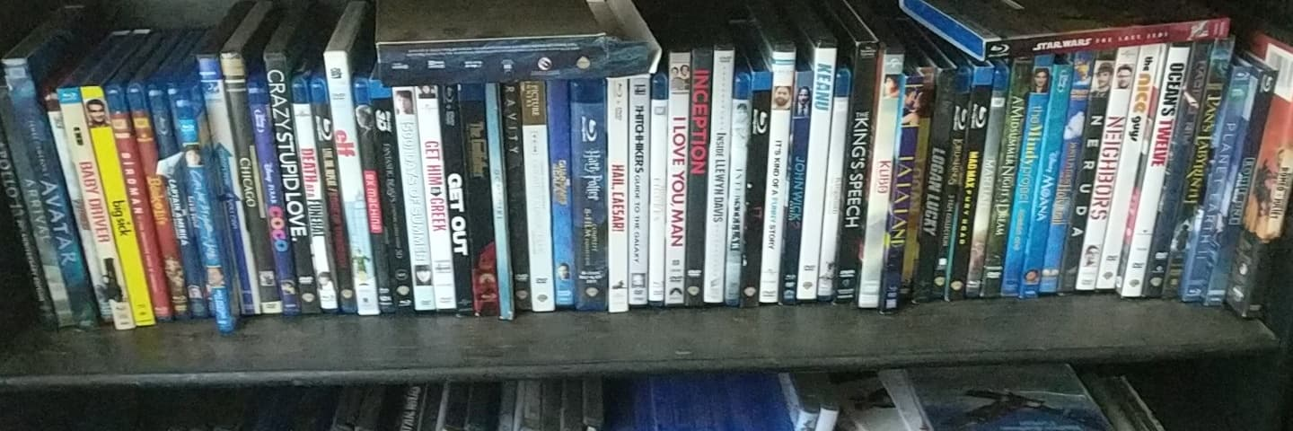 Home Viewing - John and Bethany are very much in love and they have a lot of movies. Some might say they have too many! In an effort to stop John from buying even more, they're watching them in alphabetical order and talking about them. Welcome to Home Viewing!