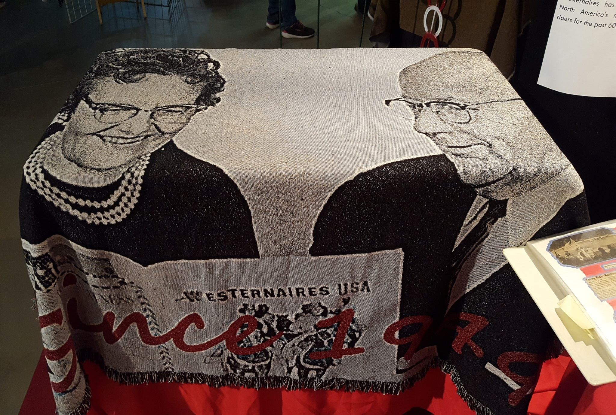 """The """"Since 1949"""" woven wall hanging / couch throw was a much-coveted auction item"""