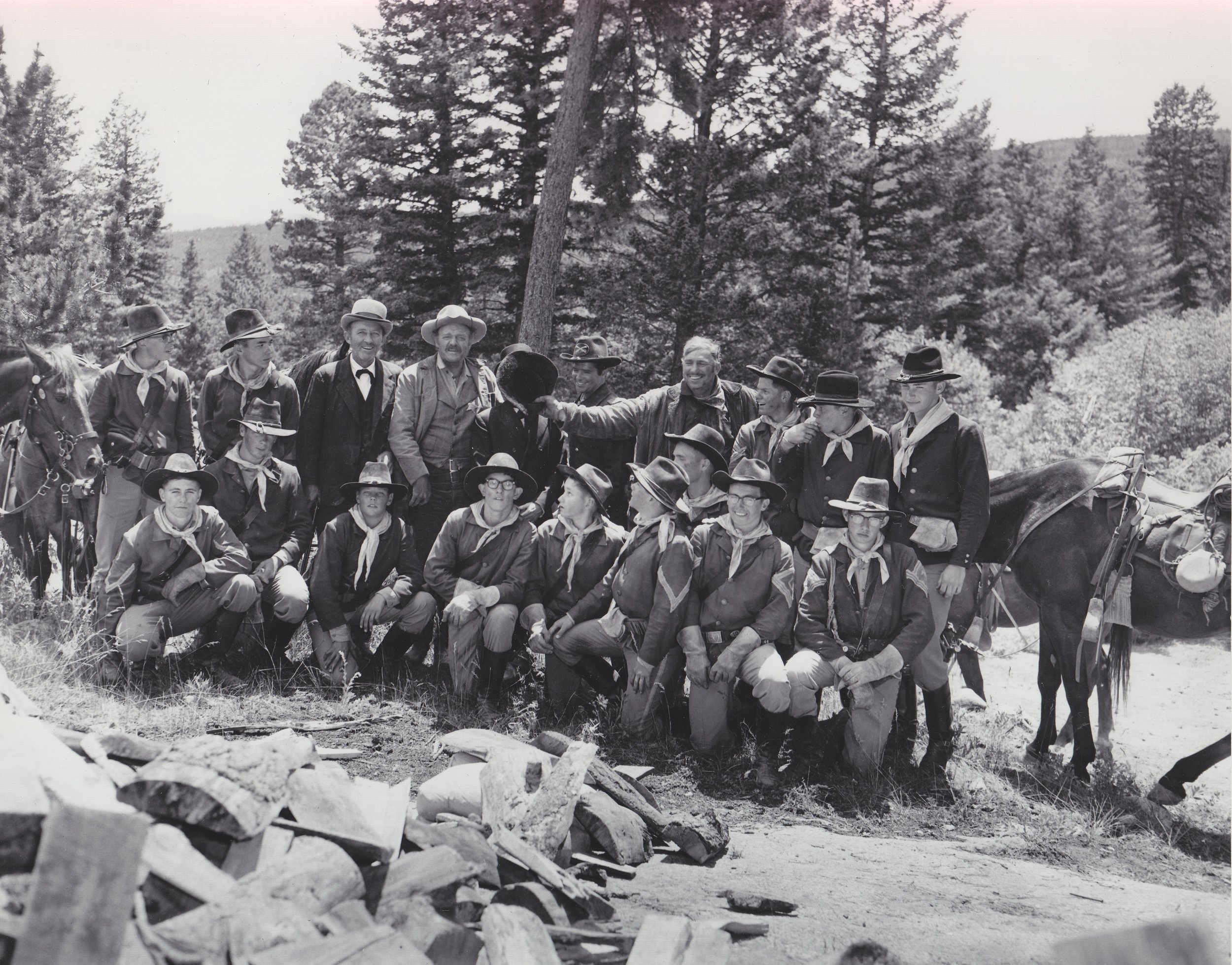 The Westernaires Cavalry team takes a break from shooting  Stagecoach  (1966).  Centered in the top row, the stars (left to right) are: Bing Crosby, Van Heflin, Red Buttons (with his face covered), Joseph Hoover, and Slim Pickens (clowning around).