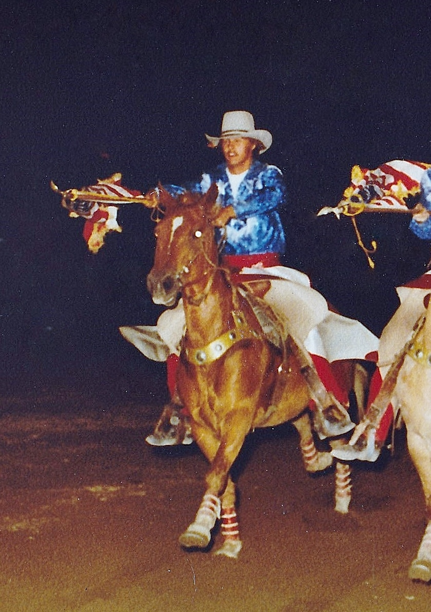 Varsity Red Team Alumnus Gary Feazell as he dashes out of the arena at the 1980 Festival of the West