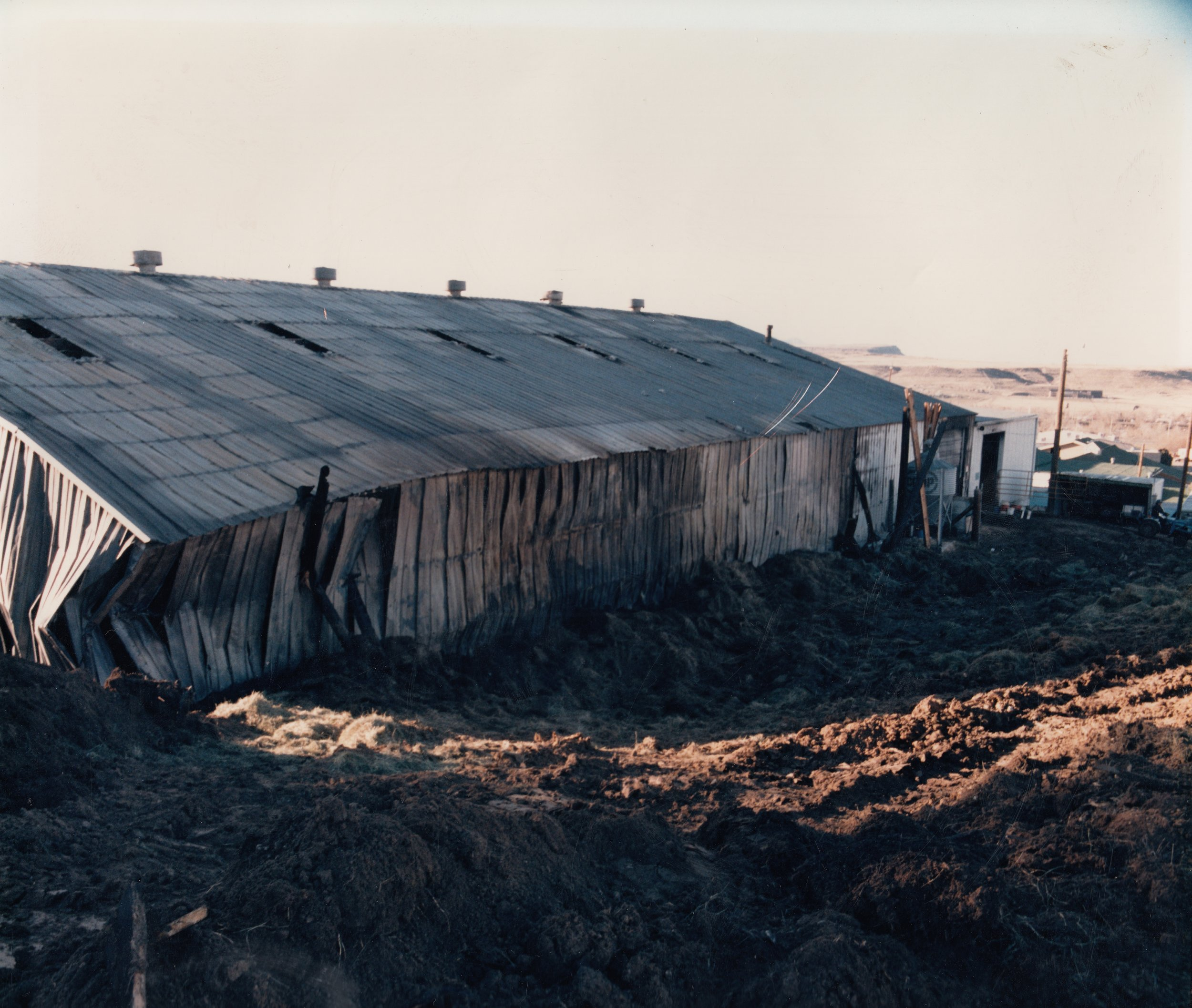 The Westernaires Red Arena's exterior, post-fire, March 1986.  The fire reached such high temperatures that it melted steel.