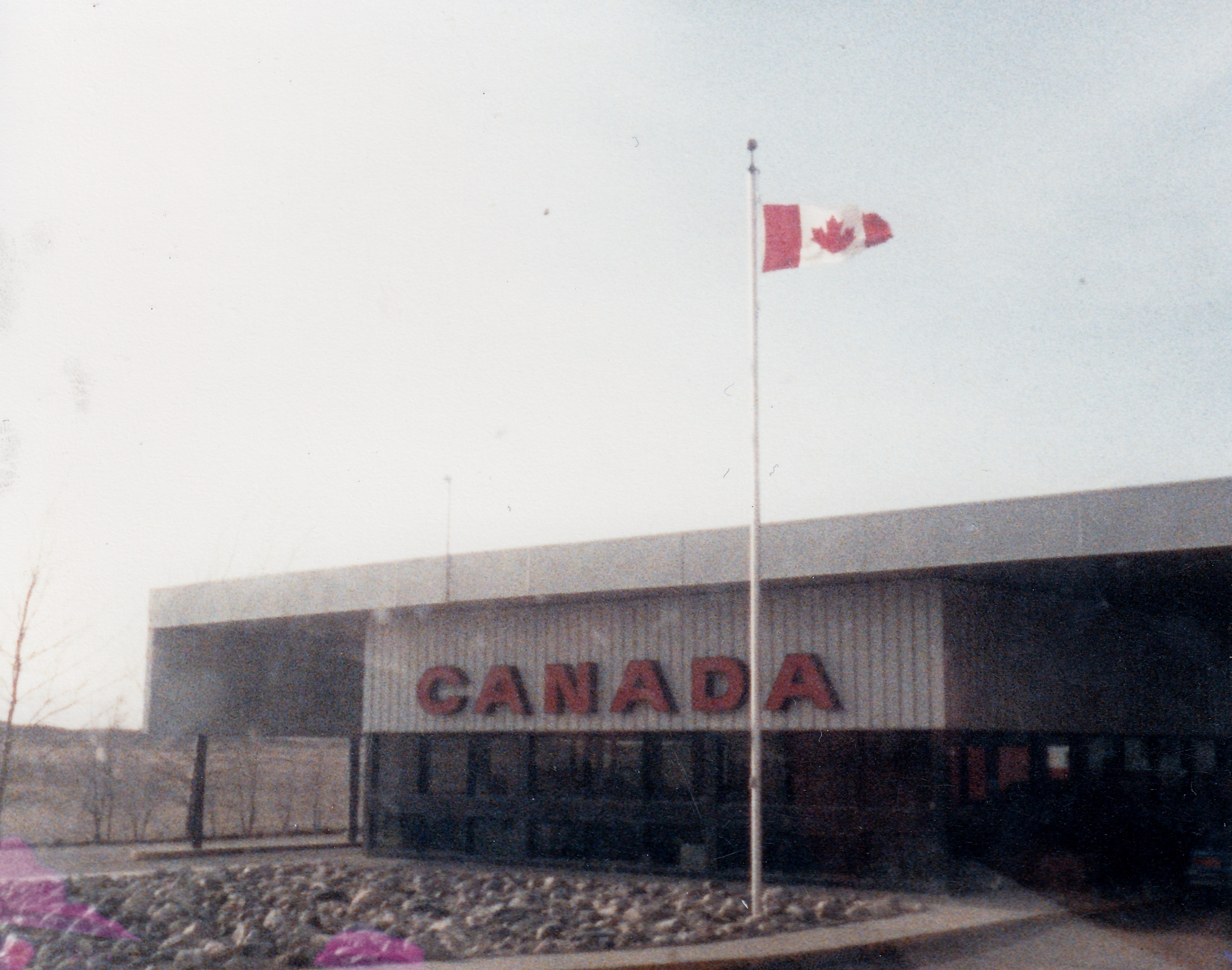 The Canadian border agency in Regway, from the window of the Westernaires bus in March of 1986.