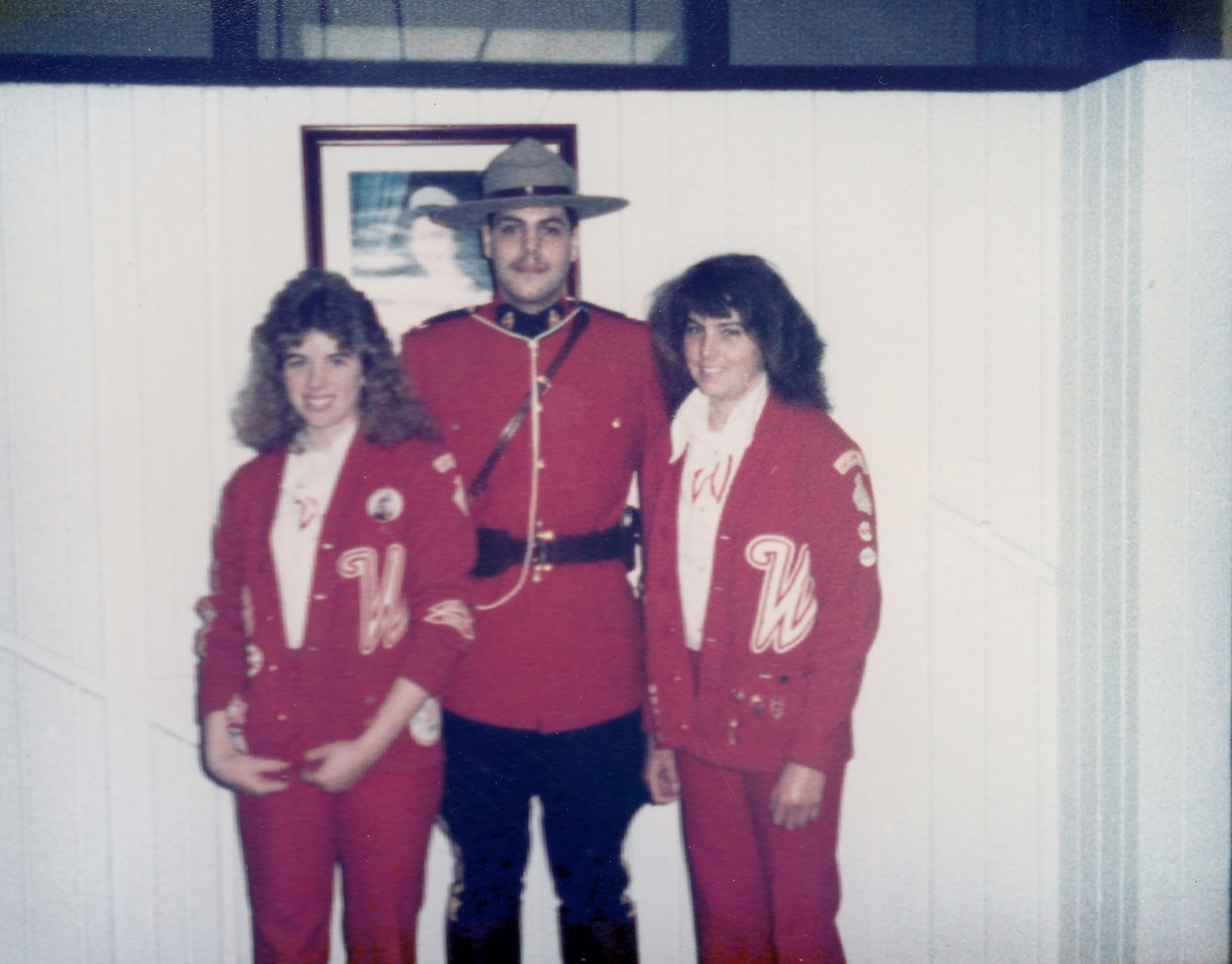 Varsity Red Team riders Shelley Underwood (left) and Chris Padilla (right) pose with with a Mountie