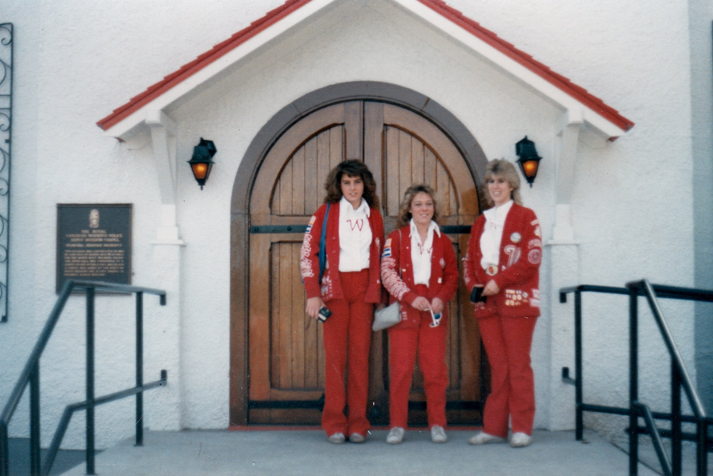 Varsity Red Team riders tour the RCMP Chapel:the oldest remaining building in Regina. Left to right: Varsity Red Team riders Christine Padilla, Lori Mosier, and Kristen Vardaman.