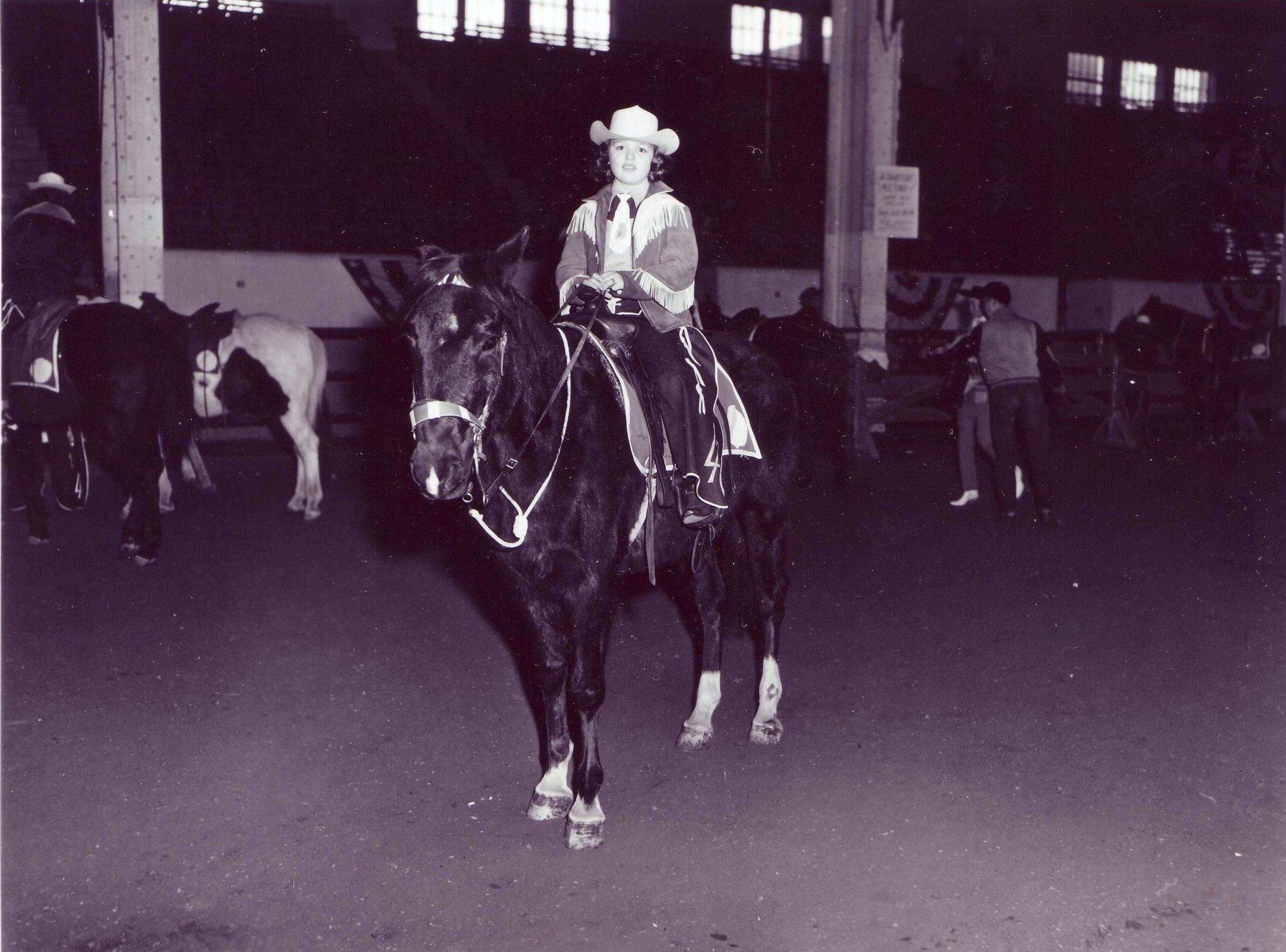 Carol Ann Akin warms up her horse in the Stockyard Stadium