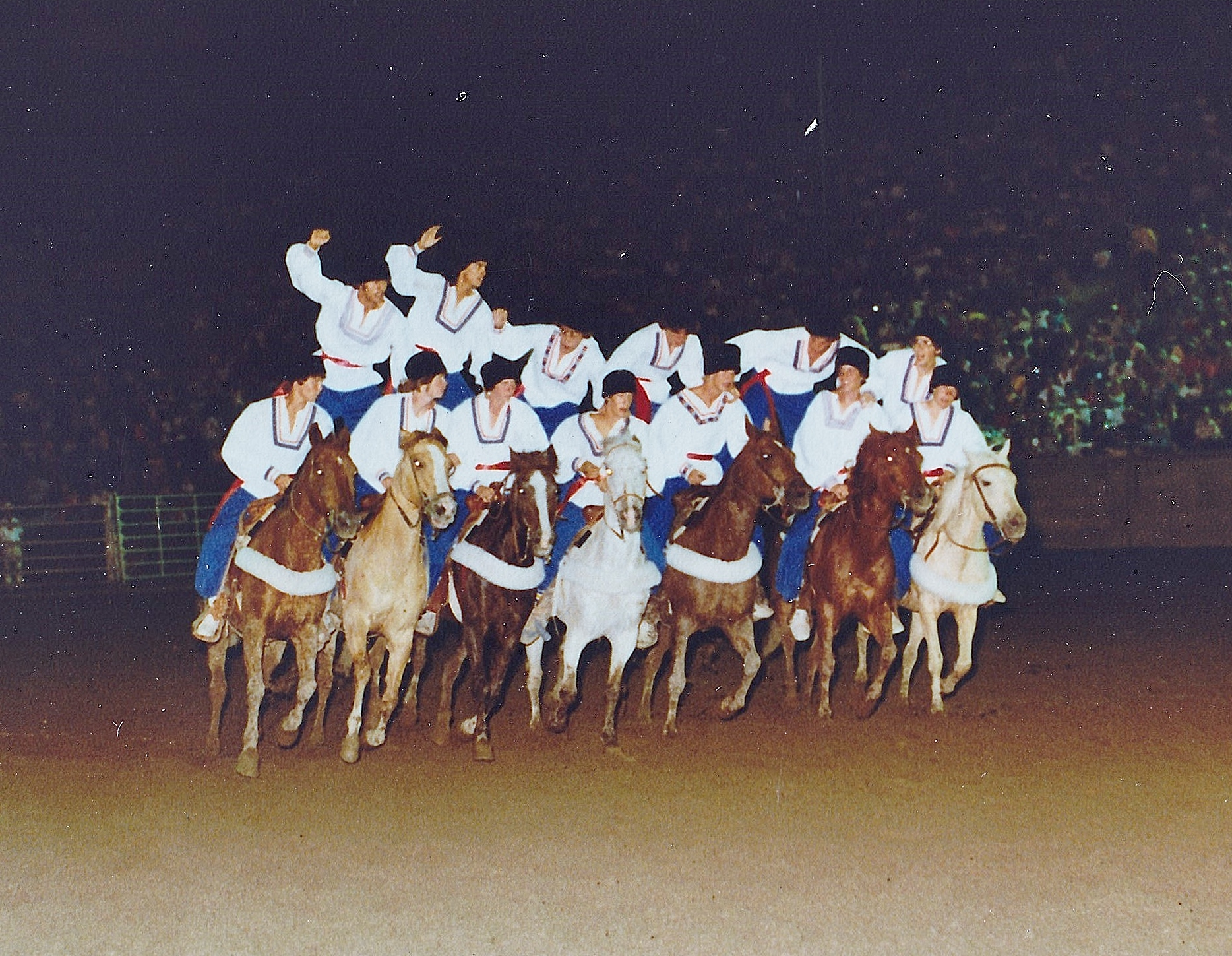 "The Riders of the Steppes team performs a ""Cossack Shuffle"" (running down the line of horses) to create their pyramid at the 1980 Festival of the West"