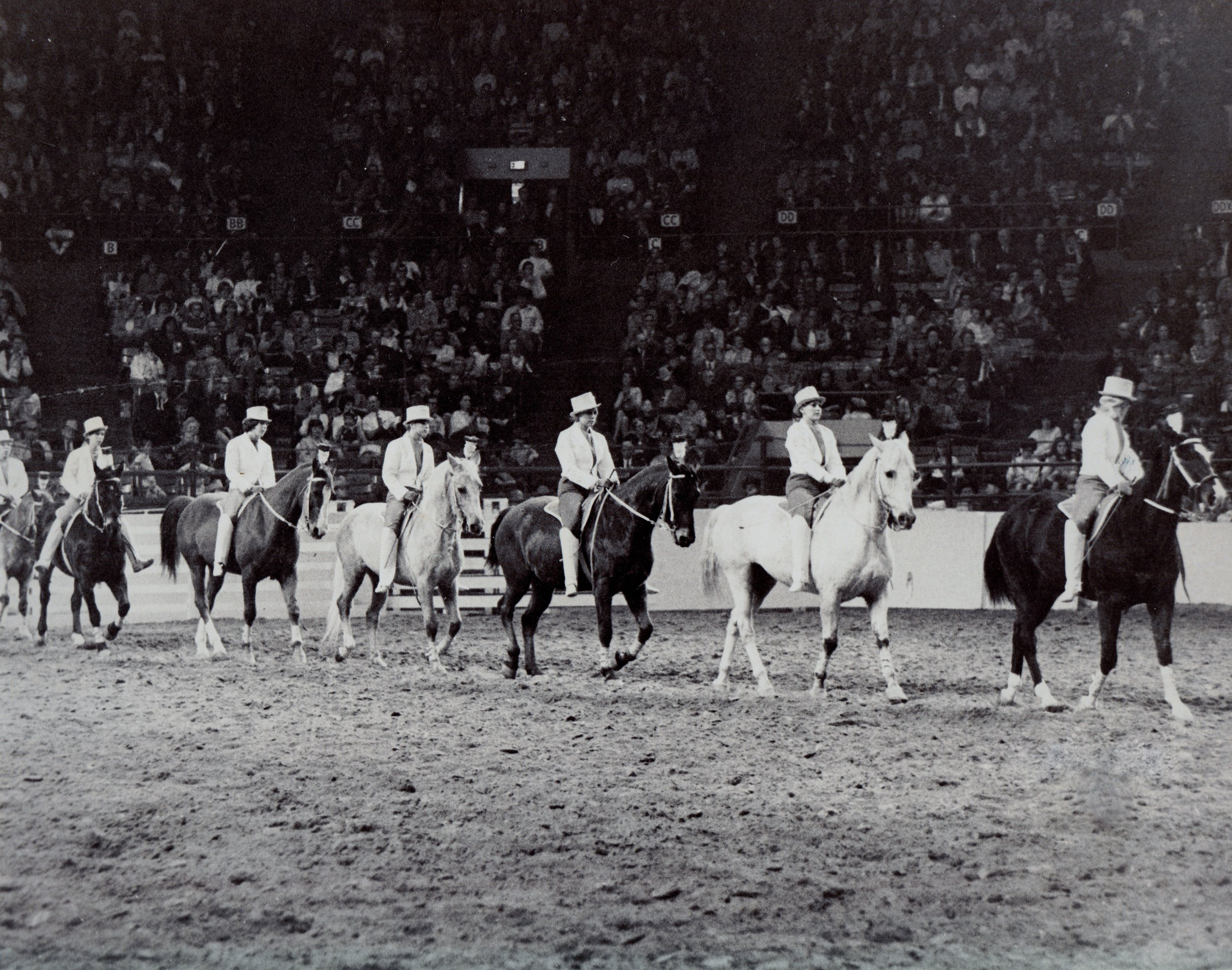 Dressage Captain Melody Mundell, followed by Sharon Easley, leads the Dressage team into their gracefully-measured act, 1969.