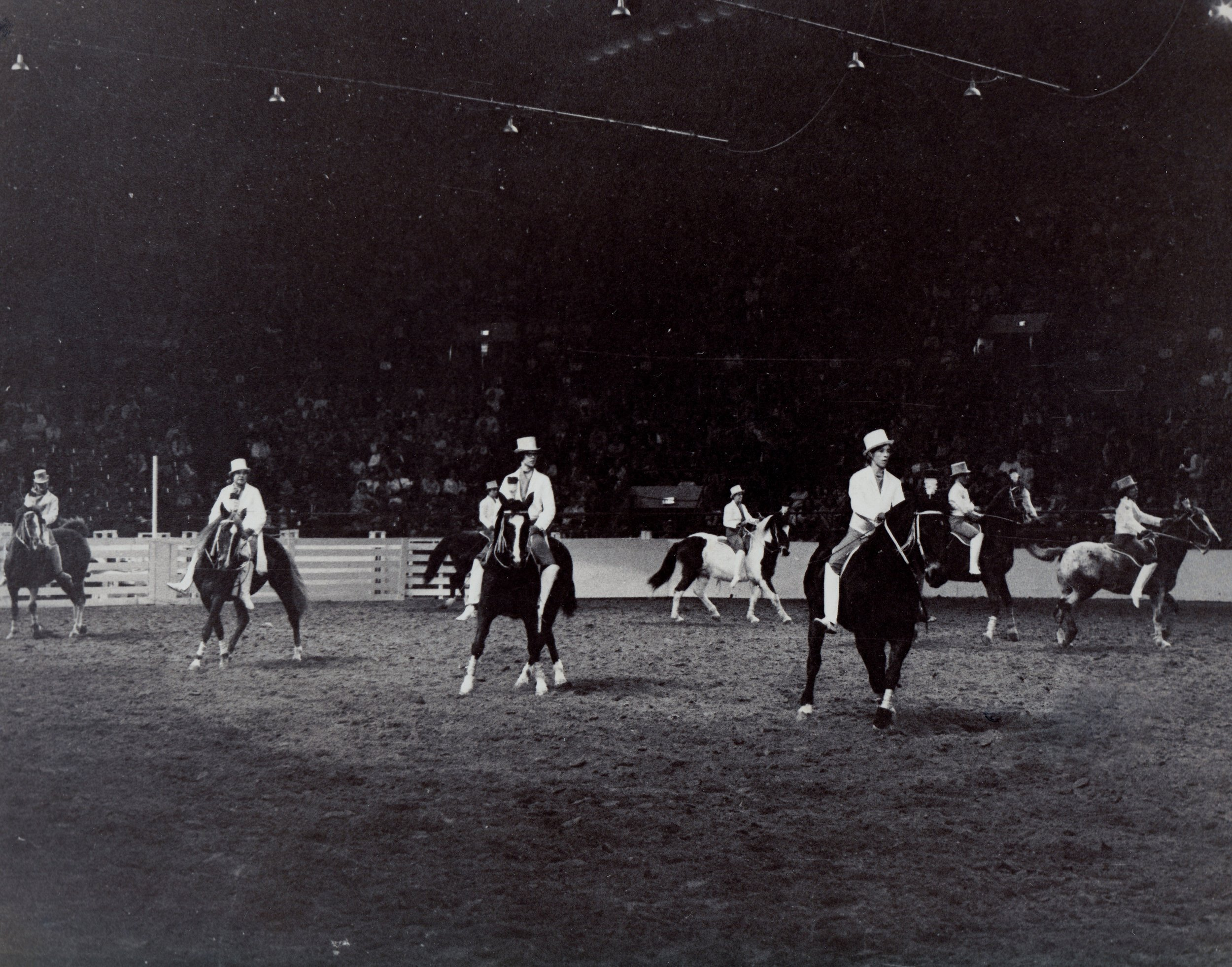 Riders perform the side-pass maneuver at the 1969 National Western Stock Show.