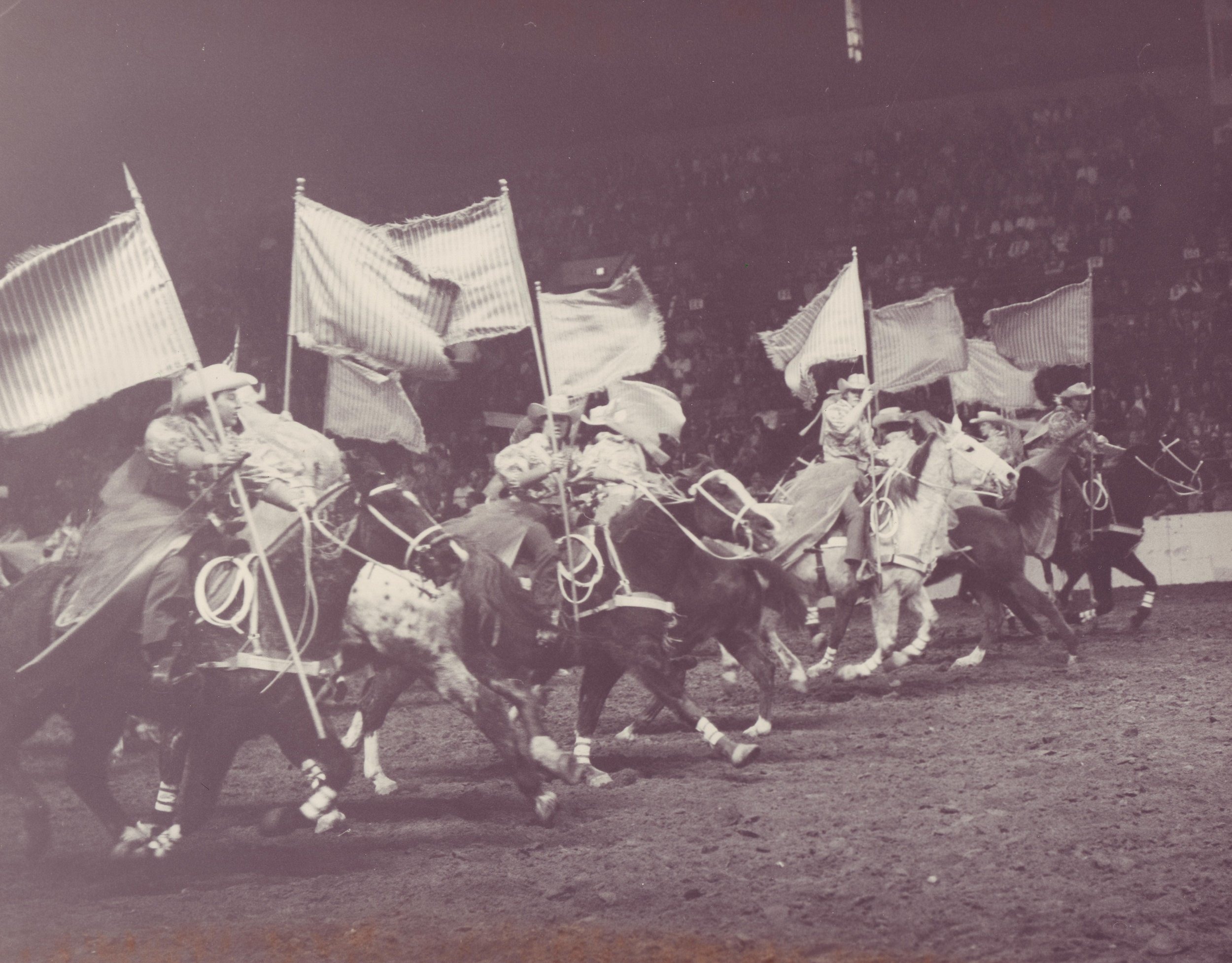 "Perfection of speed, timing, and spacing is abundantly evident in the ""Starburst"" maneuver, performed by the Westernaires Varsity Big Red Team at the 1967 National Western Stock Show."