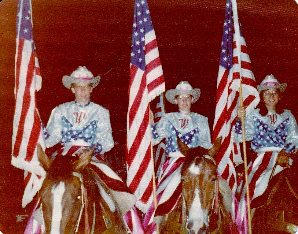 Varsity Red Team Majors (from left to right): Judy Hudgins, Janice Green, and Ann Melle at the 1976 National Western Stock Show.