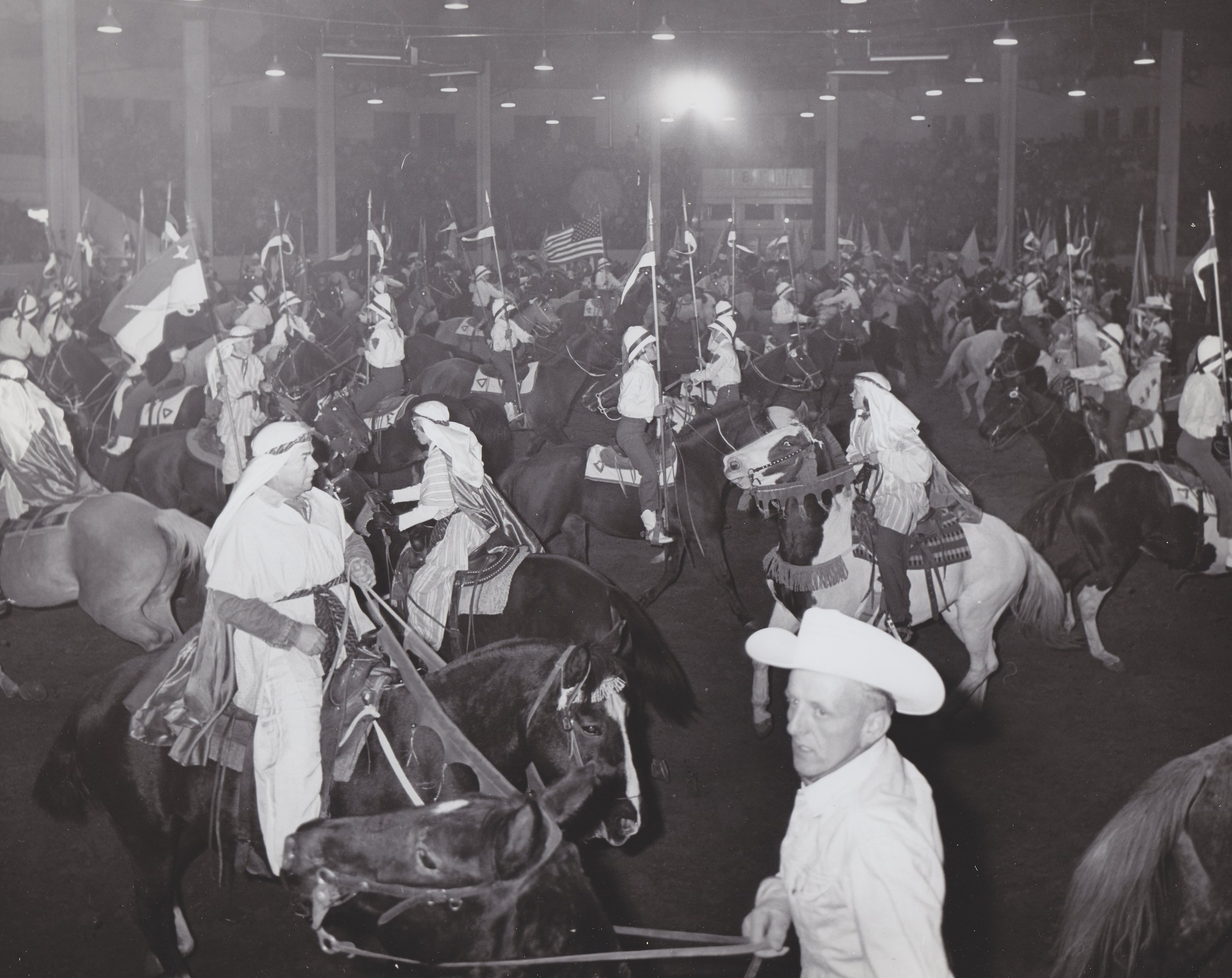 The Grand Entry serpentine at the 1957 Westernaires Horsecapades Annual Show.