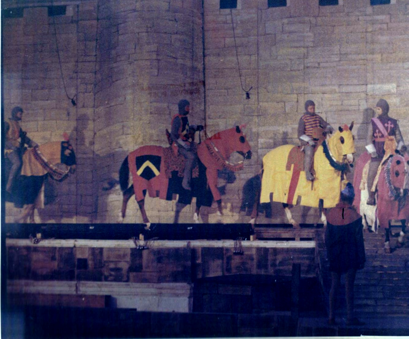Westernaires riding across the narrow ramps criss-crossing the stage of  Camelot