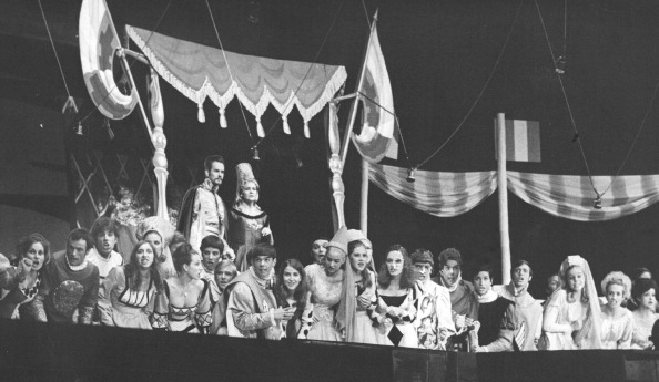 Wynne Miller as Queen Guinevere and Robert Peterson as King Arthur are joined by court attendants in watching a joust in the production  Camelot .  Camelot  was the 36th annual production free to the public by the Denver Opera Foundation.