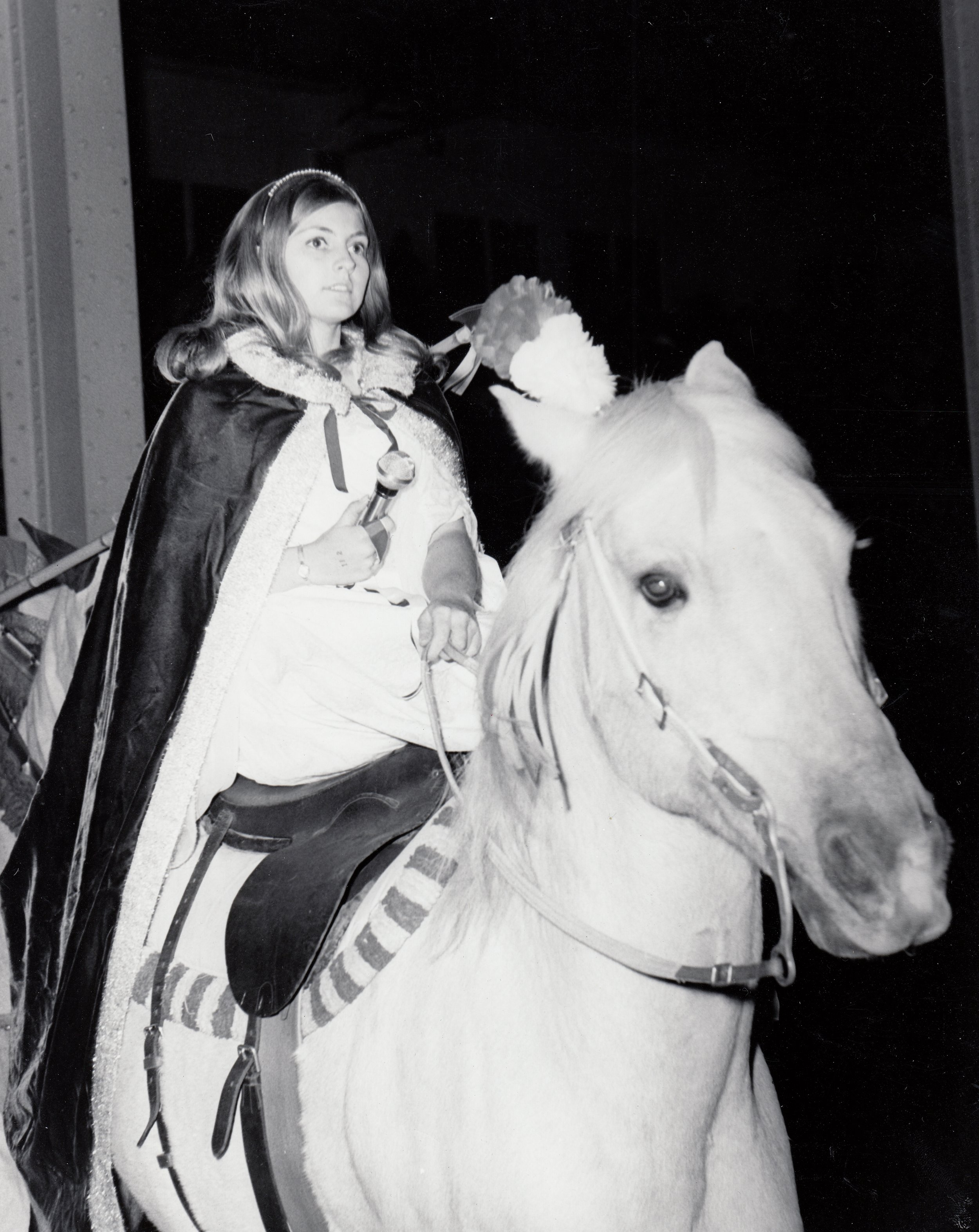Alumna Sharon Easley, sidesaddle on Yacca, preparing to sing the title number from  Camelot  at the 1969 Horsecapades annual show.