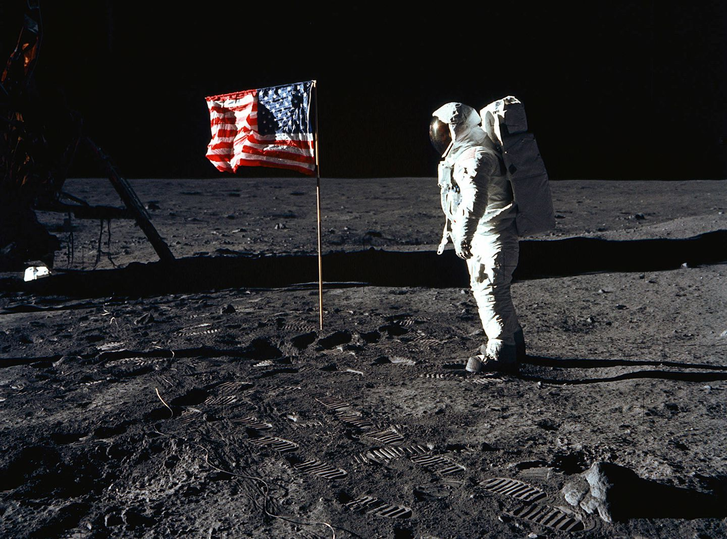 U.S. astronauts of the Apollo 11 take their first steps on the moon's surface, July 20th, 1969