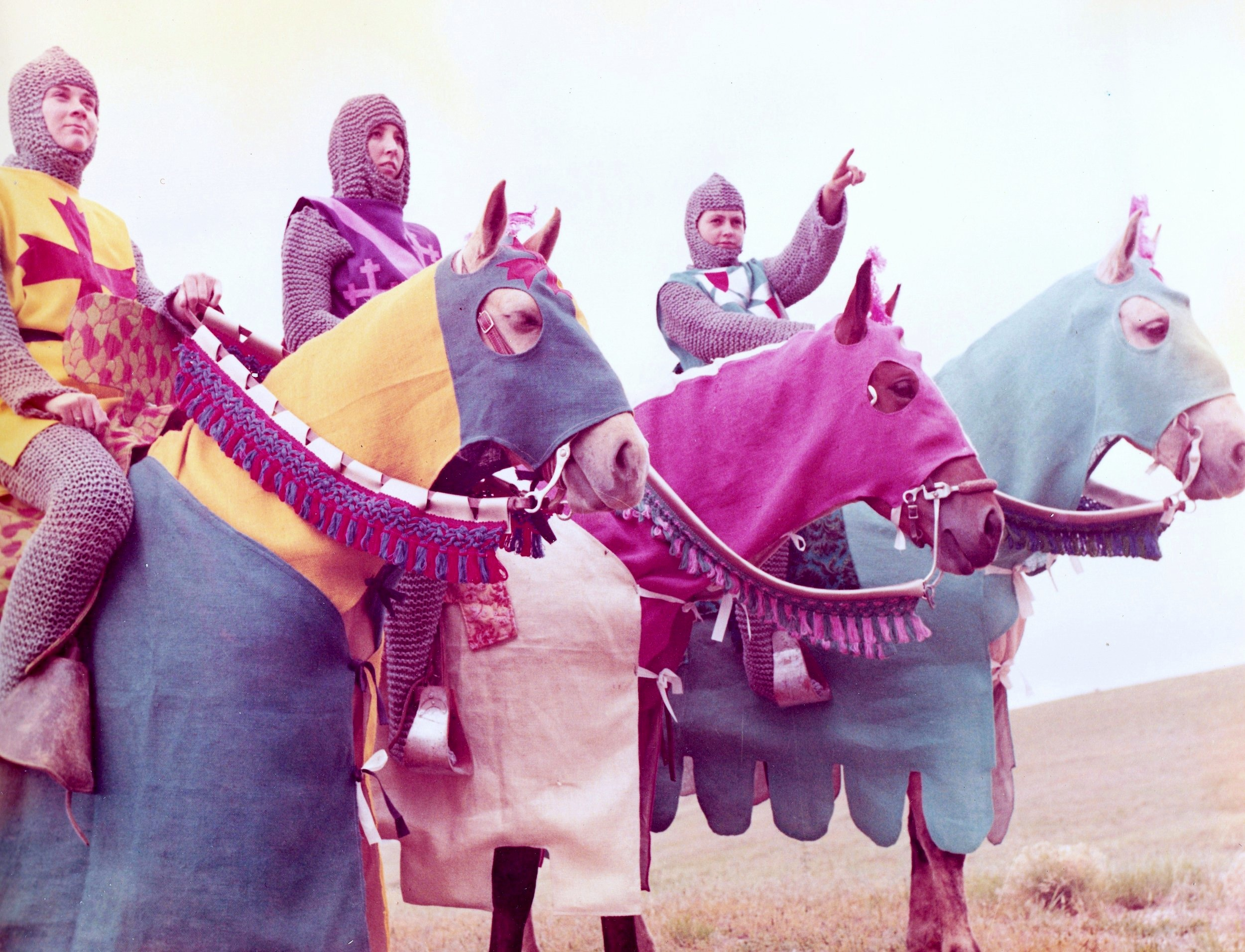 Westernaires riders Lib Clement, Mari Stannard, and Sharon Easley on Green Mountain in their Camelot costumes. In this shot one can see the detailed work that went into designing the jousting saddles, rider costuming, and horse costuming.