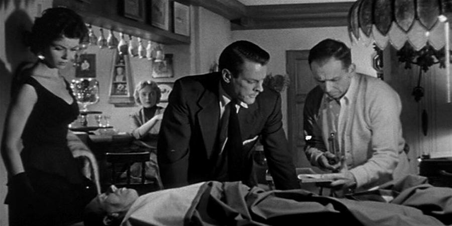 Invasion-of-the-Body-Snatchers-1956_examine-body.jpg